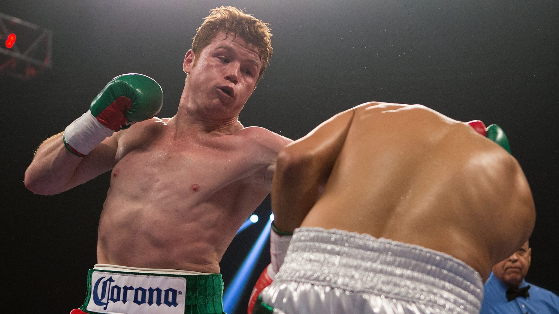LAS VEGAS, NV - SEPTEMBER 15:  (L-R) Canelo Alvarez lands a left to the head of Josesito Lopez during their WBC super  welterweight title fight at MGM Grand Garden Arena on September 15, 2012 in Las Vegas, Nevada. (Photo by Josh Hedges/Getty Images)