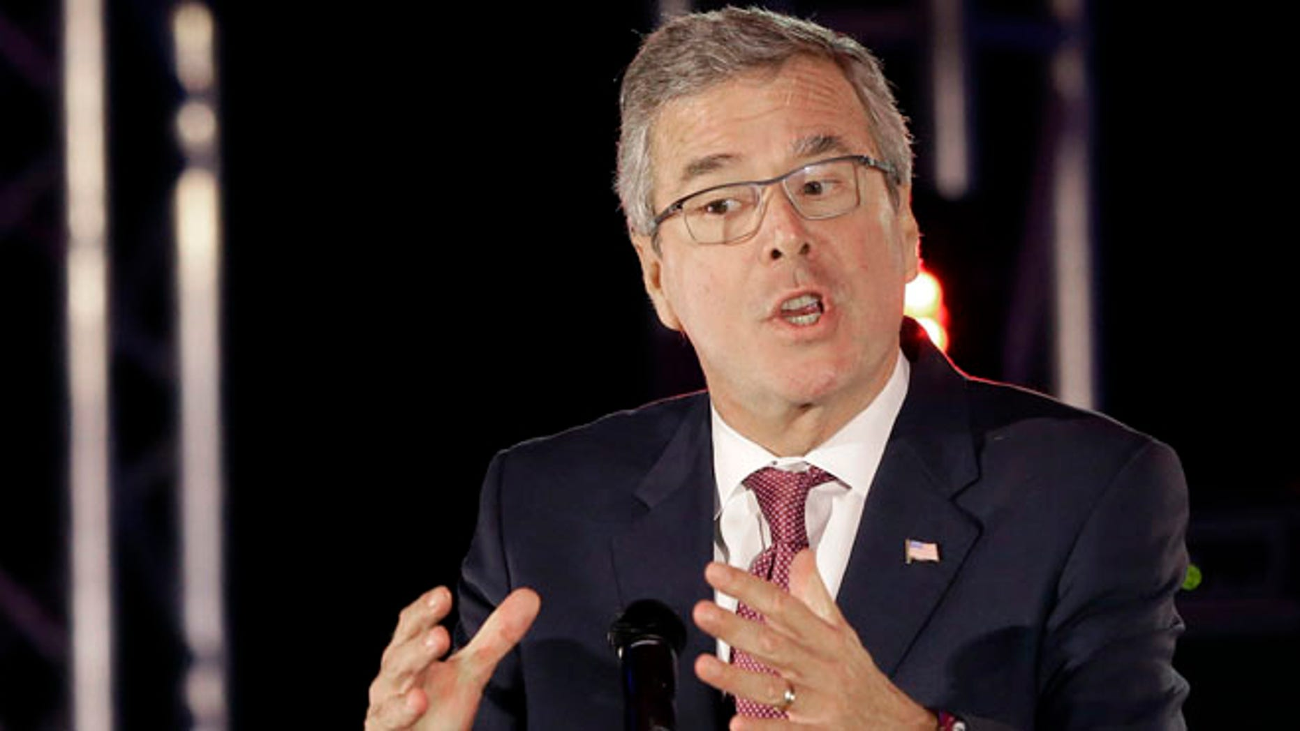FILE - In this April 29,2015 file photo, former Florida Gov. Jeb Bush speaks in Houston. He spoke in a language most Republican presidential primary voters do not understand. âYou are part of the new wave of hope for this country,â Jeb Bush said in fluent Spanish to the National Hispanic Christian Leadership Conference this week. Switching to English, he said the U.S. needs immigrants for the country âto become young and dynamic again.â  (AP Photo/Pat Sullivan, File)