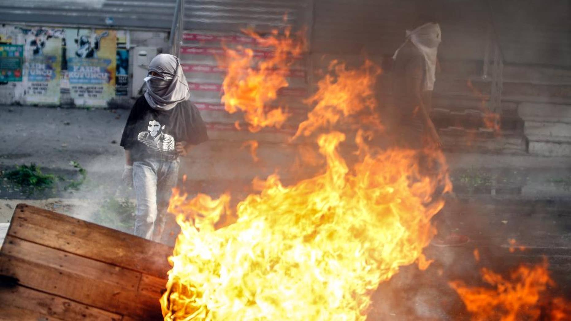 Masked leftist militants clash with security forces during a protest in Gazi district in Istanbul, Turkey, Sunday, Aug. 23, 2015. (AP Photo/Cagdas Erdogan) TURKEY OUT