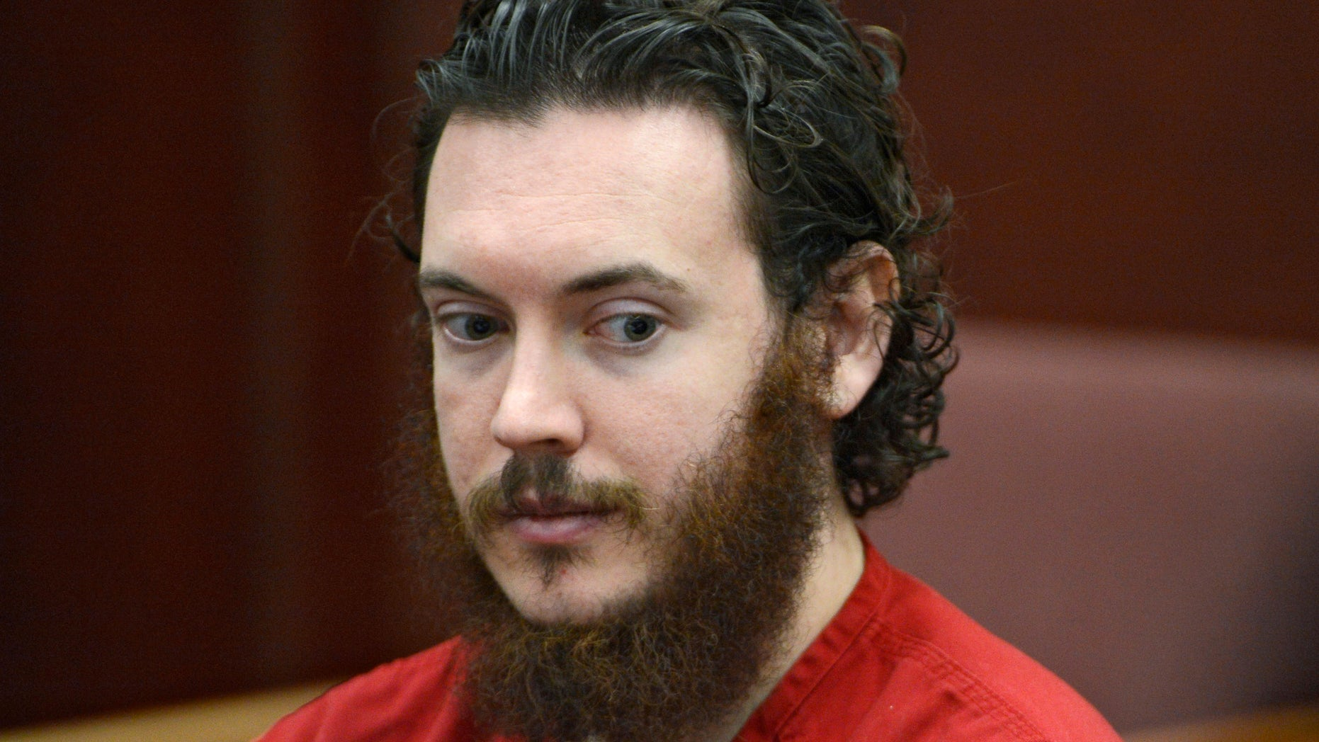 FILE -This June 4, 2013 file photo shows Aurora theater shooting suspect James Holmes in court in Centennial, Colo. On Tuesday, Oct. 15, 2013, Holmes' lawyers will argue that the two hours that passed before he was read his Miranda rights violated his constitutional rights and that anything he told the arresting officers should be barred from his trial.  (AP Photo/The Denver Post, Andy Cross, Pool, File)