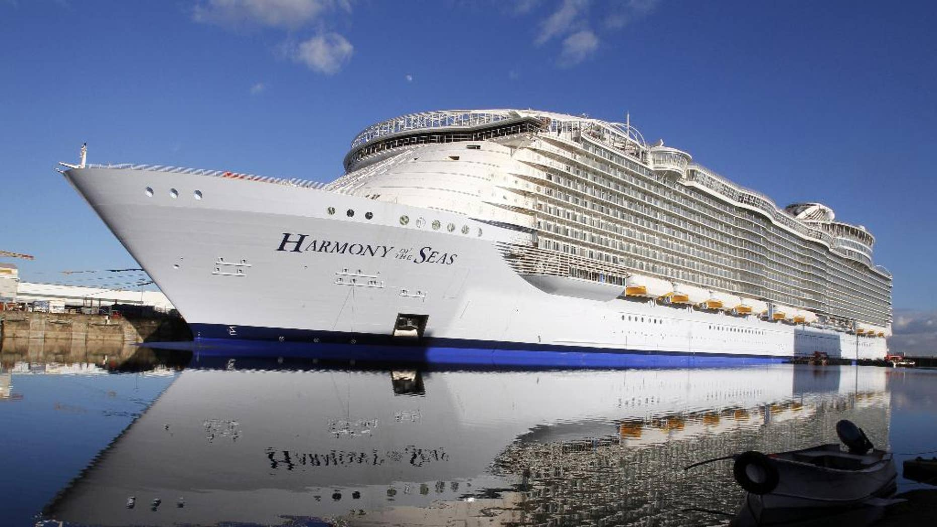 """FILE- In this  Feb. 18, 2016 file photo, the """"Harmony of the Seas"""" docks at the STX Shipyard in Saint-Nazaire, western France. Tens of thousands of French well-wishers waved revoir to the largest cruise ship in the world as it set sail on its maiden voyage to the U.K. after 32 months in a French shipyard. (AP Photo/Laetitia Notarianni, File)"""