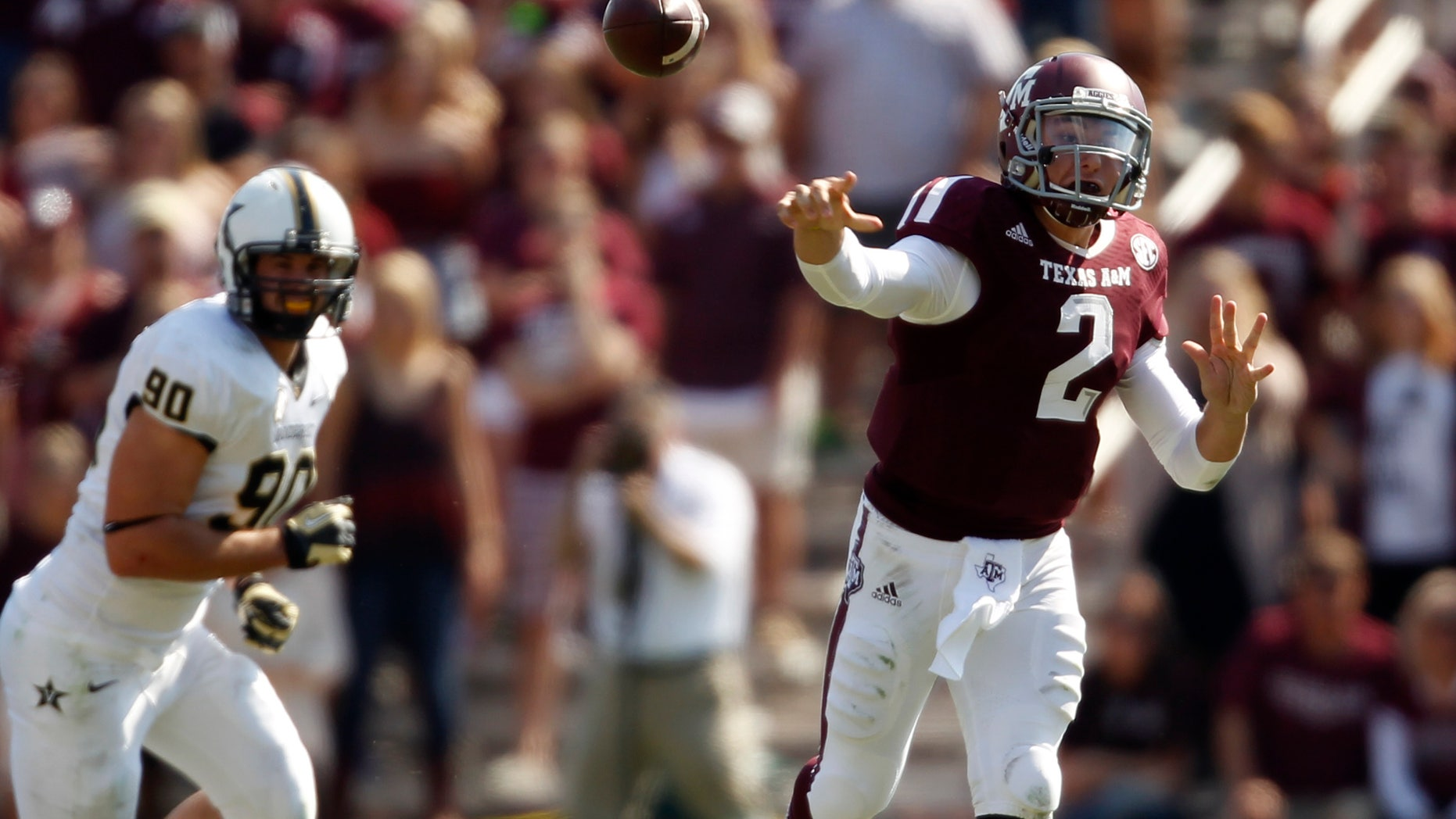 Texas A&M's Johnny Manziel (2) throws a pass during the first half of an NCAA college football game against Vanderbilt, Saturday, Oct. 26, 2013, in College Station, Texas. (AP Photo/Eric Christian Smith)