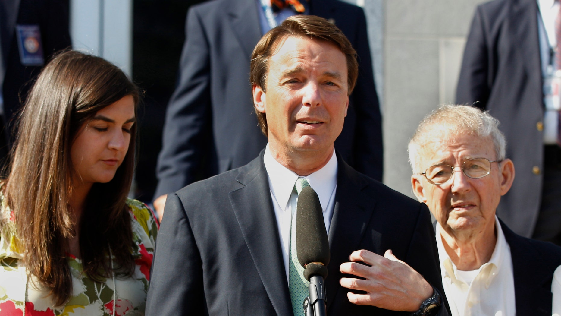 May 31, 2012:  Former presidential candidate John Edwards speaks outside a federal courthouse as his daughter, Cate Edwards, left, and father Wallace Edwards, listen after his campaign finance fraud case ended in a mistrial, in Greensboro, N.C.