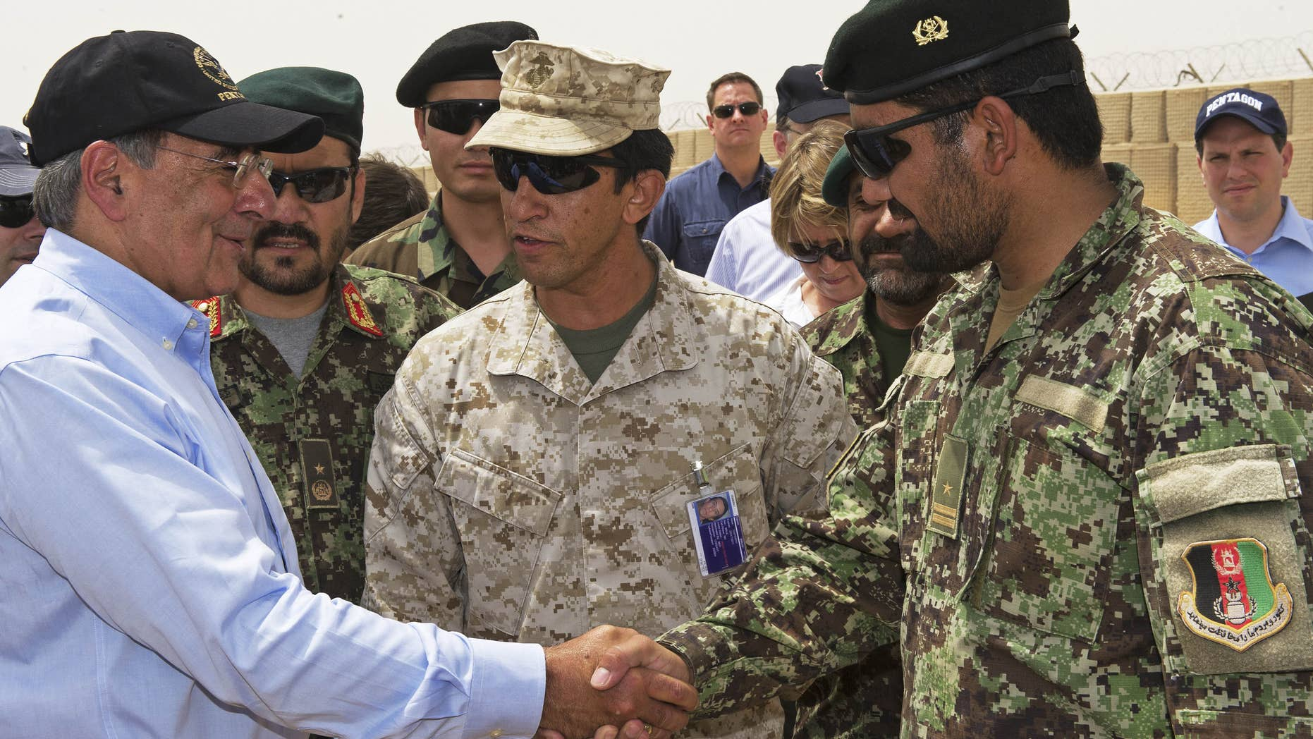 July 10: US Secretary of Defense Leon Panetta greets an Afghan military leader as he makes an unannounced visit to Camp Dwyer, in southern Afghanistan.