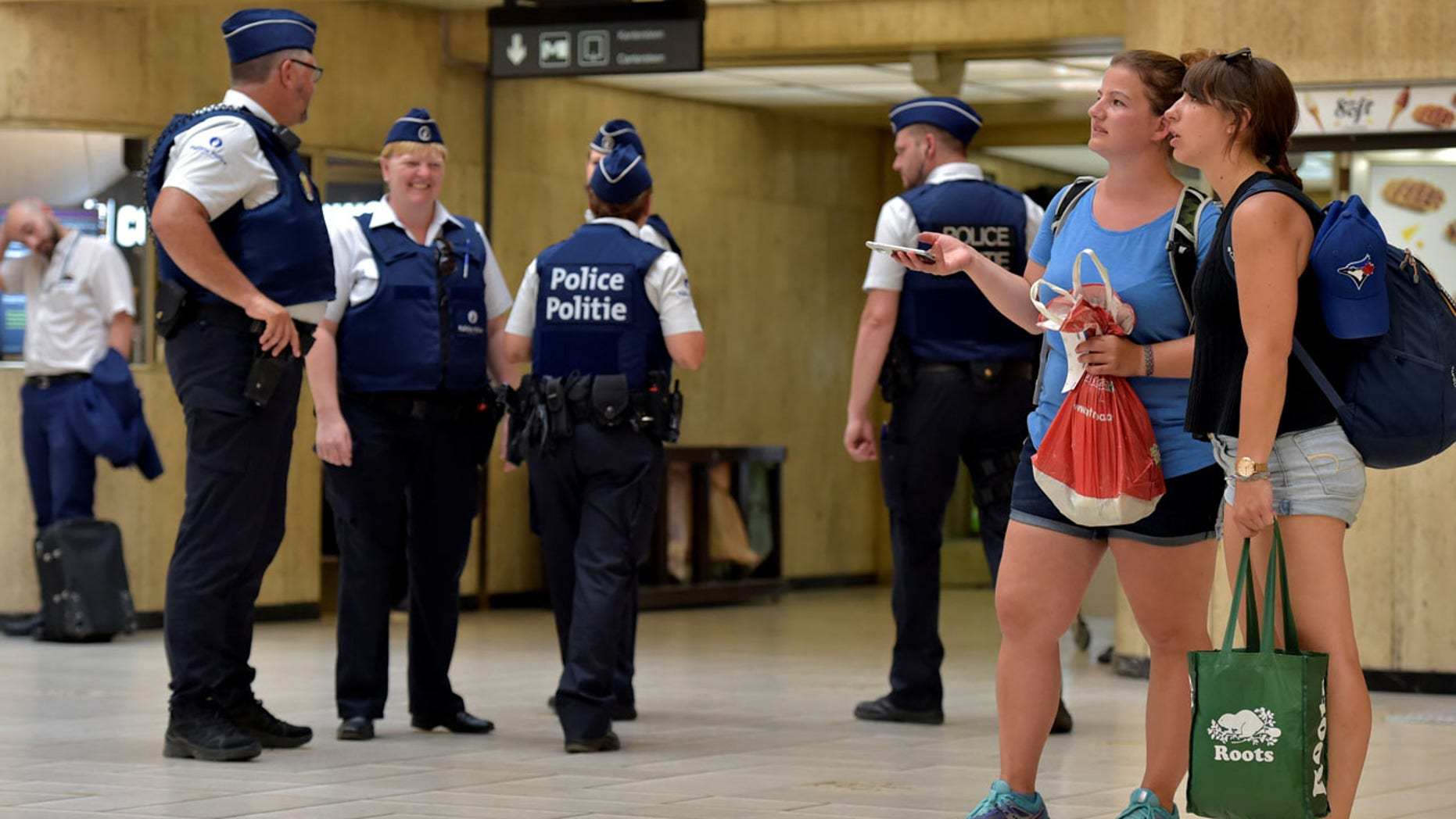 Belgian police officers stand guard in central station in Brussels, Belgium