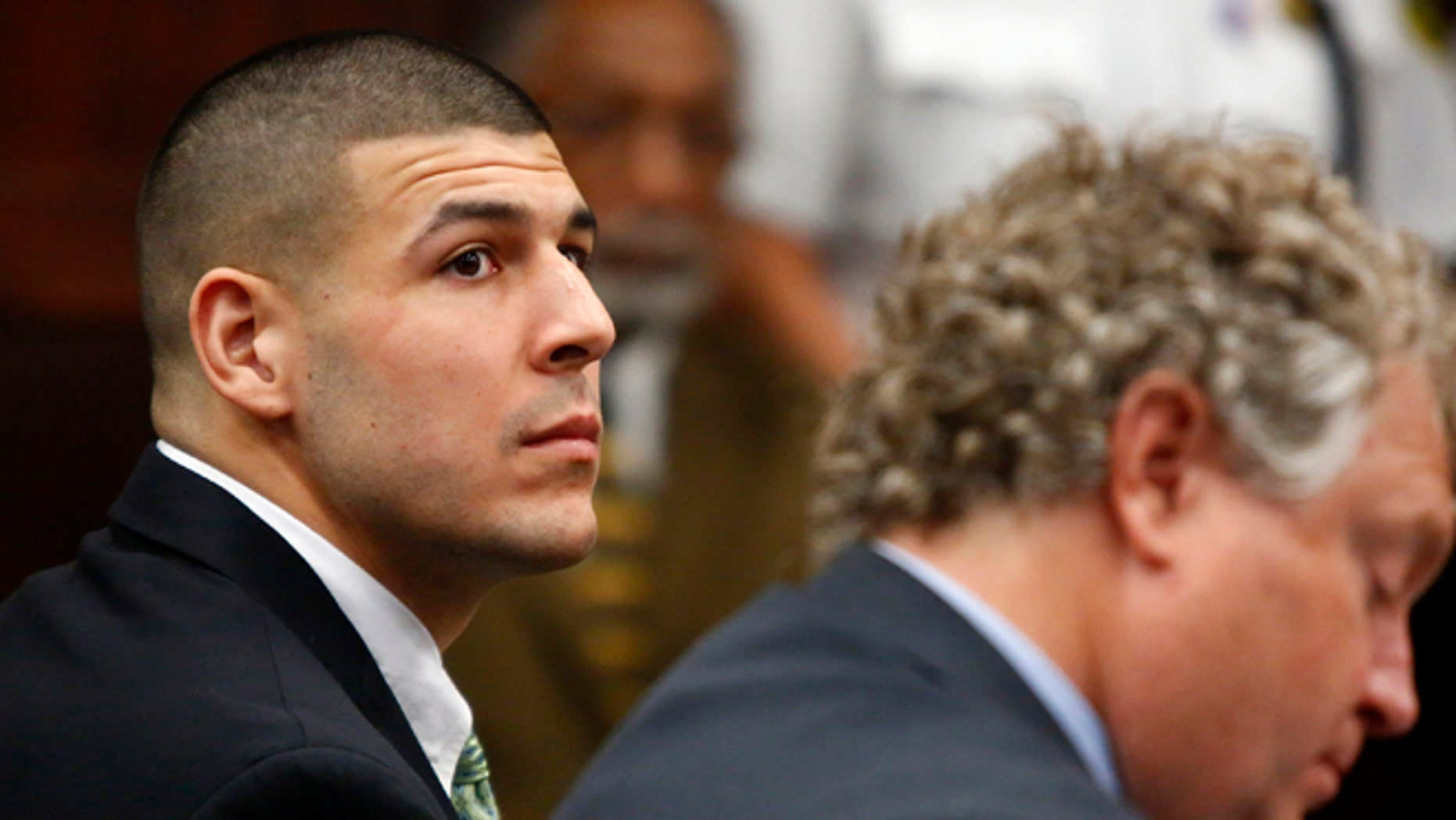 FILE -  Hernandez, jailed while awaiting trial in the killing of three men, is Mr. July in the Florida Gators' 2014 sports calendar, with the school saying Tuesday, July 1, 2014, that officials approved the publication months before he was charged with murder.