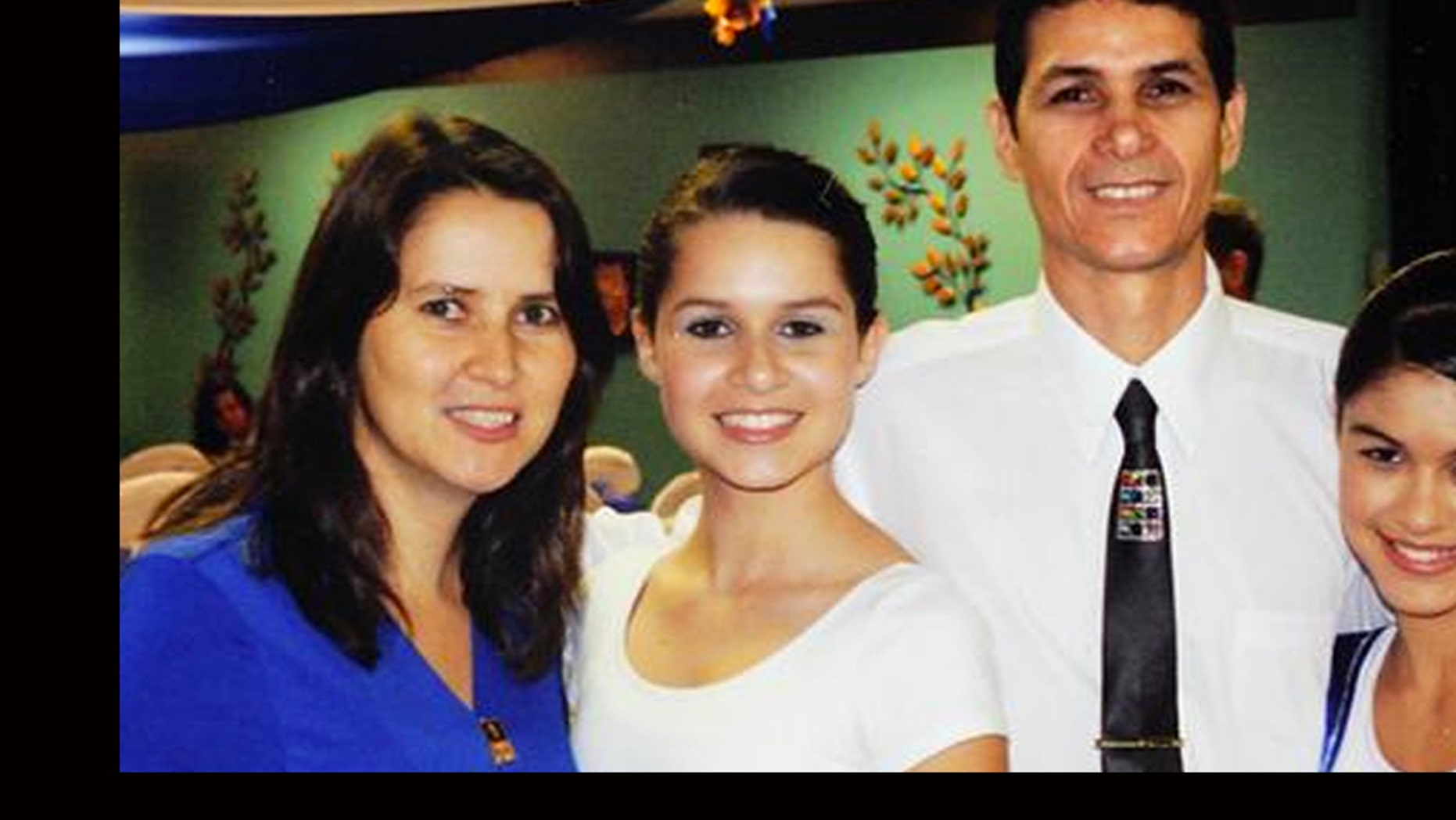 In this undated photo released by  the International Church of the Restoration in Marietta, Ga., The Carmo family, Adriana, Leticia, 17, Jose Jr. and Lidiane, 15, pose at the church in Marietta, Ga. Florida Highway Patrol spokesman Lt. Patrick Riordan confirmed Jose Carmo Jr., Adriana Carmo, Leticia Carmo and Edson Carmo, not shown in picture, as victims in the Sunday crash on Florida's Interstate 75 that killed 10 people. (AP Photo/International Church of the Restoration)
