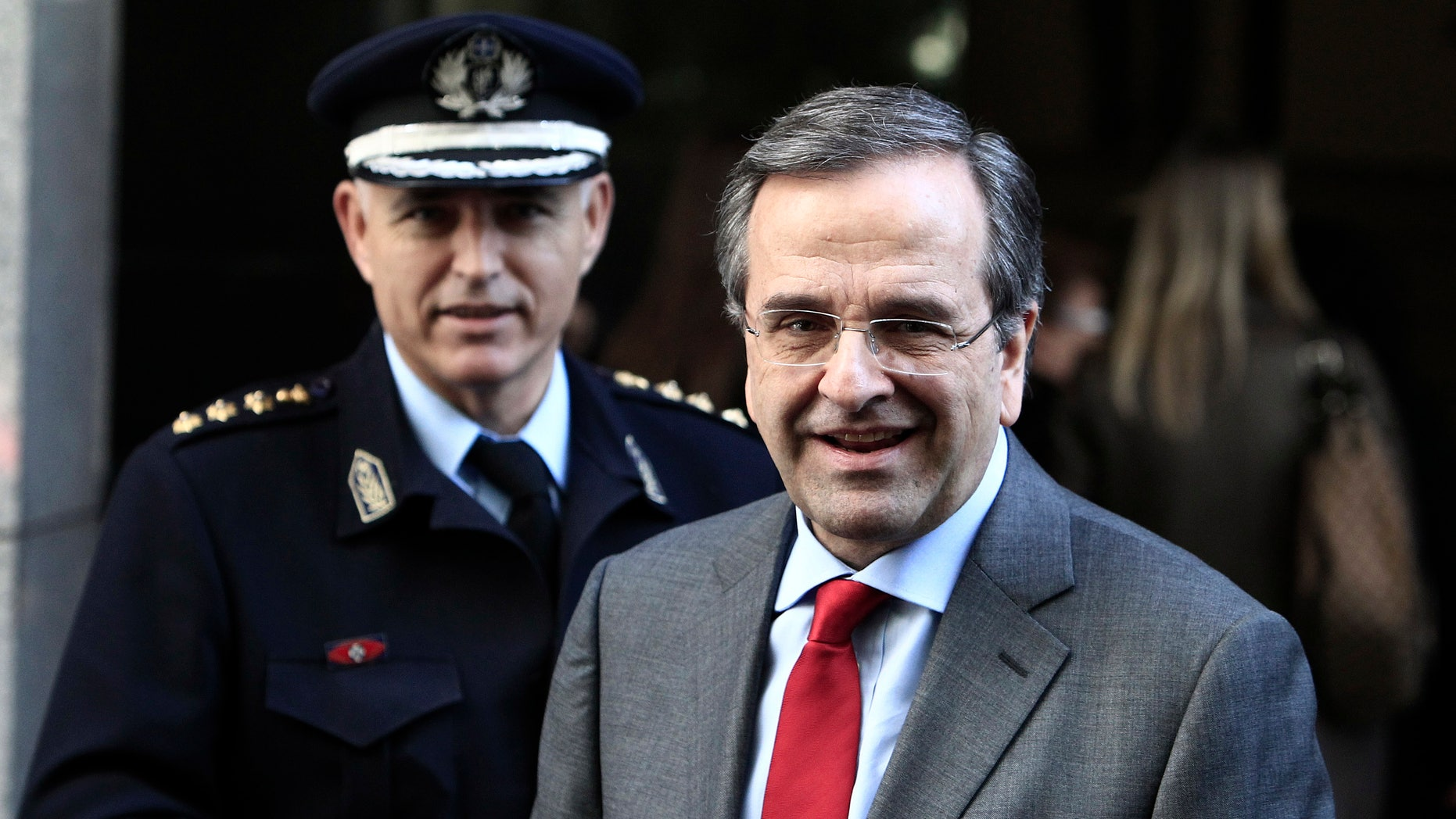 Greece's Prime Minister Antonis Samaras leaves the Finance Ministry after a meeting on cutting red tape for businesses in Athens, Monday, Feb. 17, 2014. Samaras has said that after years of deficits, Greece will post a euro1.5 billion ($ 2 billion) primary surplus in 2013, and in 2014 the country is expected to return to growth after a six-year recession. But unemployment remains at record high levels, reaching a staggering 28 percent in November. (AP Photo/Thanassis Stavrakis)