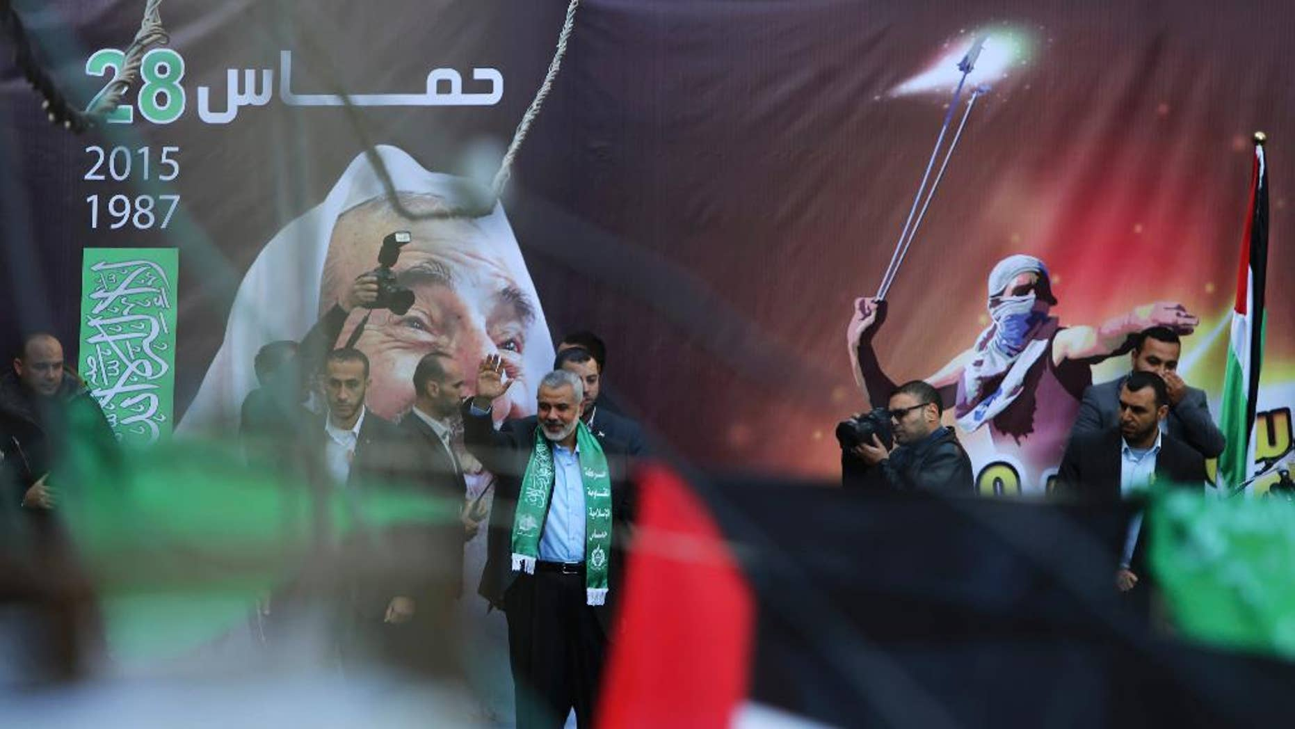 File - In this Monday, Dec. 14, 2015 file photo, Hamas leader Ismail Haniyeh, waves to supporters during a rally to commemorate the 28th anniversary of the Hamas in Gaza City. Hamas has drafted a new political program that it hopes will improve ties with neighboring Egypt and the West and present a more moderate image that will help it get off Western terrorism lists. The internationally isolated group, which has ruled the Gaza Strip for the past decade, characterizes itself in the manifesto as a Palestinian resistance movement against Israeli occupation, dropping references to holy war against Jews. It also raises the possibility of a Palestinian state in the West Bank, Gaza Strip and east Jerusalem, lands Israel captured in 1967. (AP Photo/Adel Hana, File)