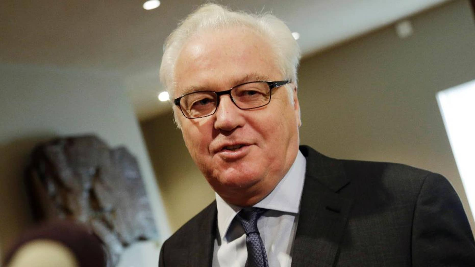 """FILE- In this Feb. 7, 2016, file photo, Russia's United Nations Ambassador Vitaly Churkin makes comments to the media prior to a Security Council meeting at U.N. headquarters. Churkin told reporters Wednesday, April 27, that the two hardline Islamic groups — Jaish al-Islam, or the Army of Islam, and Ahrar al-Sham — aren't observing the cessation of hostilities in Syria """"and are engaged in terrorist activities"""" and therefore should be subject to sanctions. (AP Photo/Mark Lennihan, File)"""