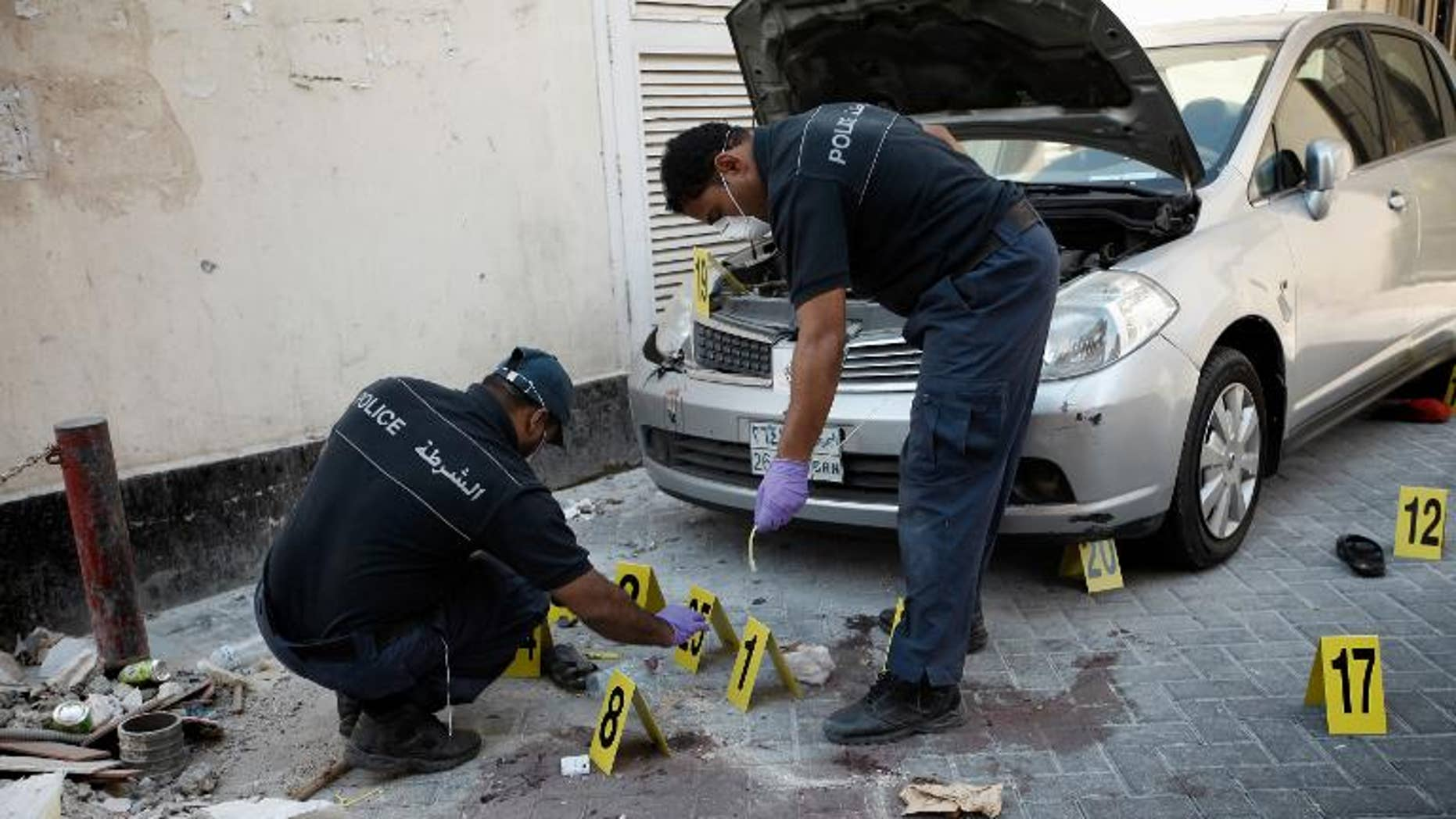 Bahraini police inspect the site of an explosion in the capital Manama, on November 5, 2012