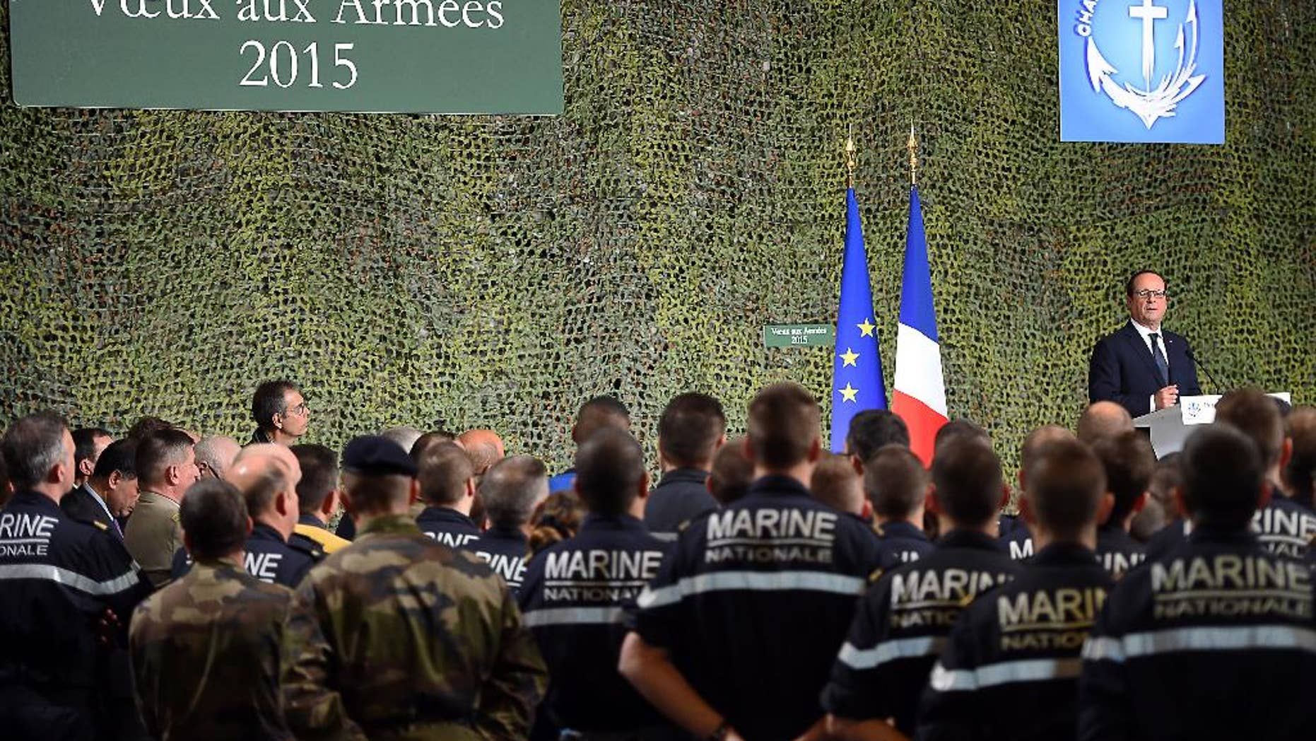 French President Francois Hollande delivers a speech during his visit to the French nuclear aircraft carrier Charles de Gaulle to present his New Year wishes to the French military troops, Wednesday, Jan. 14, 2015, off the coast of Toulon, southern France. France ordered prosecutors around the country to crack down on hate speech, anti-Semitism and glorifying terrorism and announced Wednesday it was sending an aircraft carrier to the Mideast to work more closely with the U.S.-led coalition fighting Islamic State militants. (AP Photo/ Anne Christine Poujoulat /Pool)
