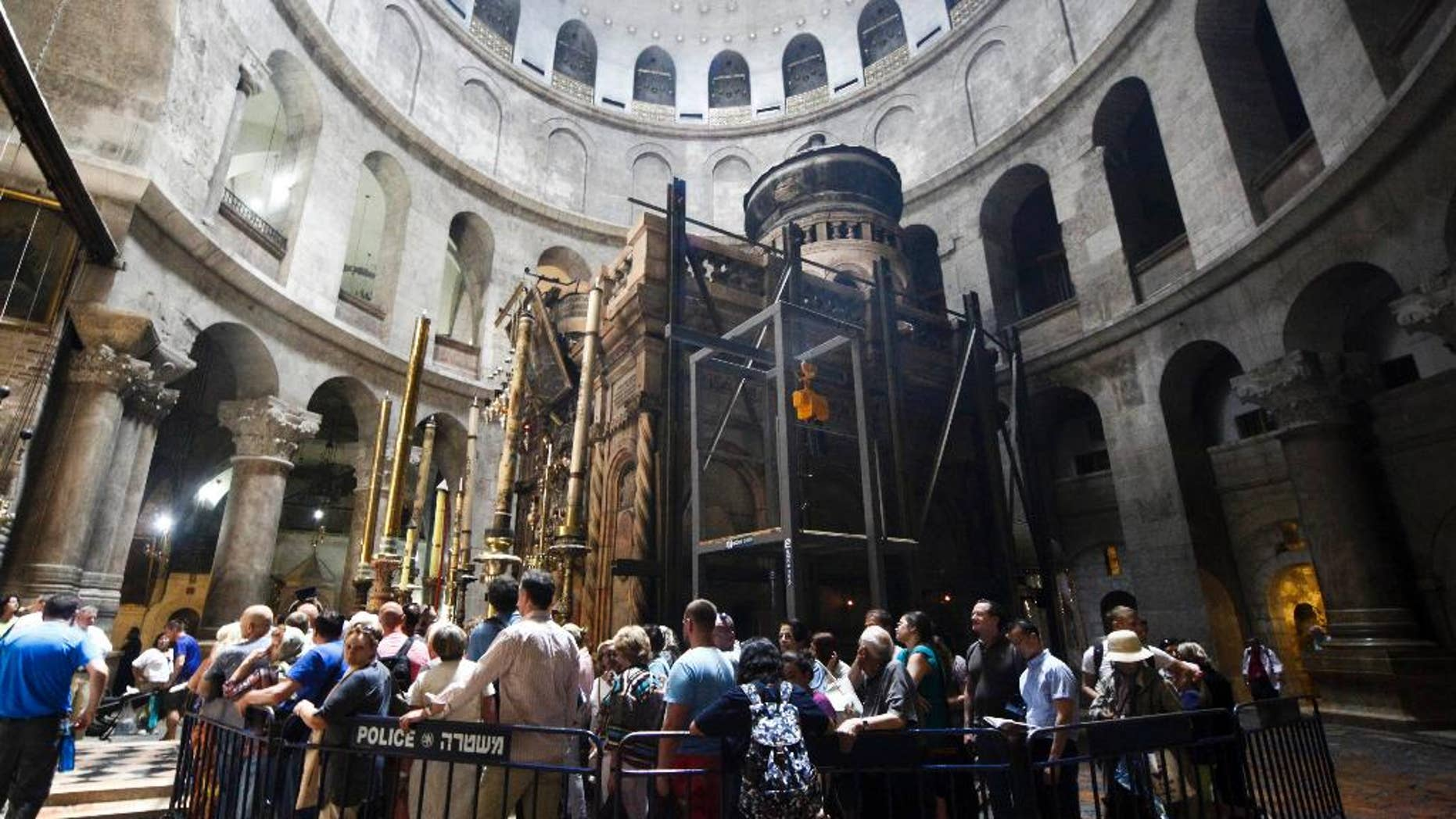 Christian pilgrims wait in line to visit the tomb of Jesus Christ in the Church of Holy Sepulcher in Jerusalem Friday, May 20, 2016. Christian officials have launched historic restoration work at the Tomb of Jesus inside the Church of Holy Sepulcher, site where tradition holds Jesus was crucified, buried and resurrected. The works are the first in almost two centuries that will focus on repairing, reinforcing and conserving the structure. (AP Photo/Mahmoud Illean)