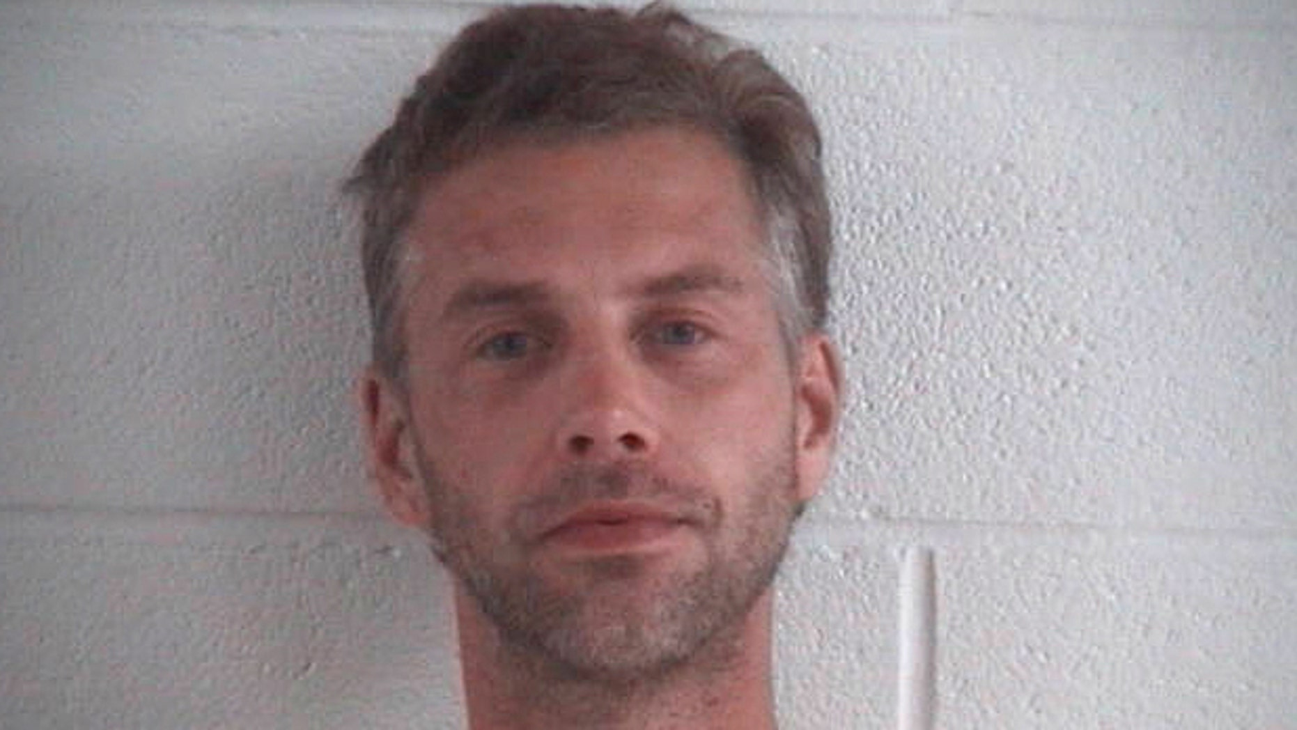 This photo provided by Ashland County Sheriff Office shows Shawn M. Grate.   Grate, was arrested Tuesday, Sept. 13, 2016, in Ashland, Ohio in connection to the investigation of a rescued abductee and the discovery of the remains of two people in the home where he was arrested. (Ashland County Sheriff Office /The Times Gazette via AP)