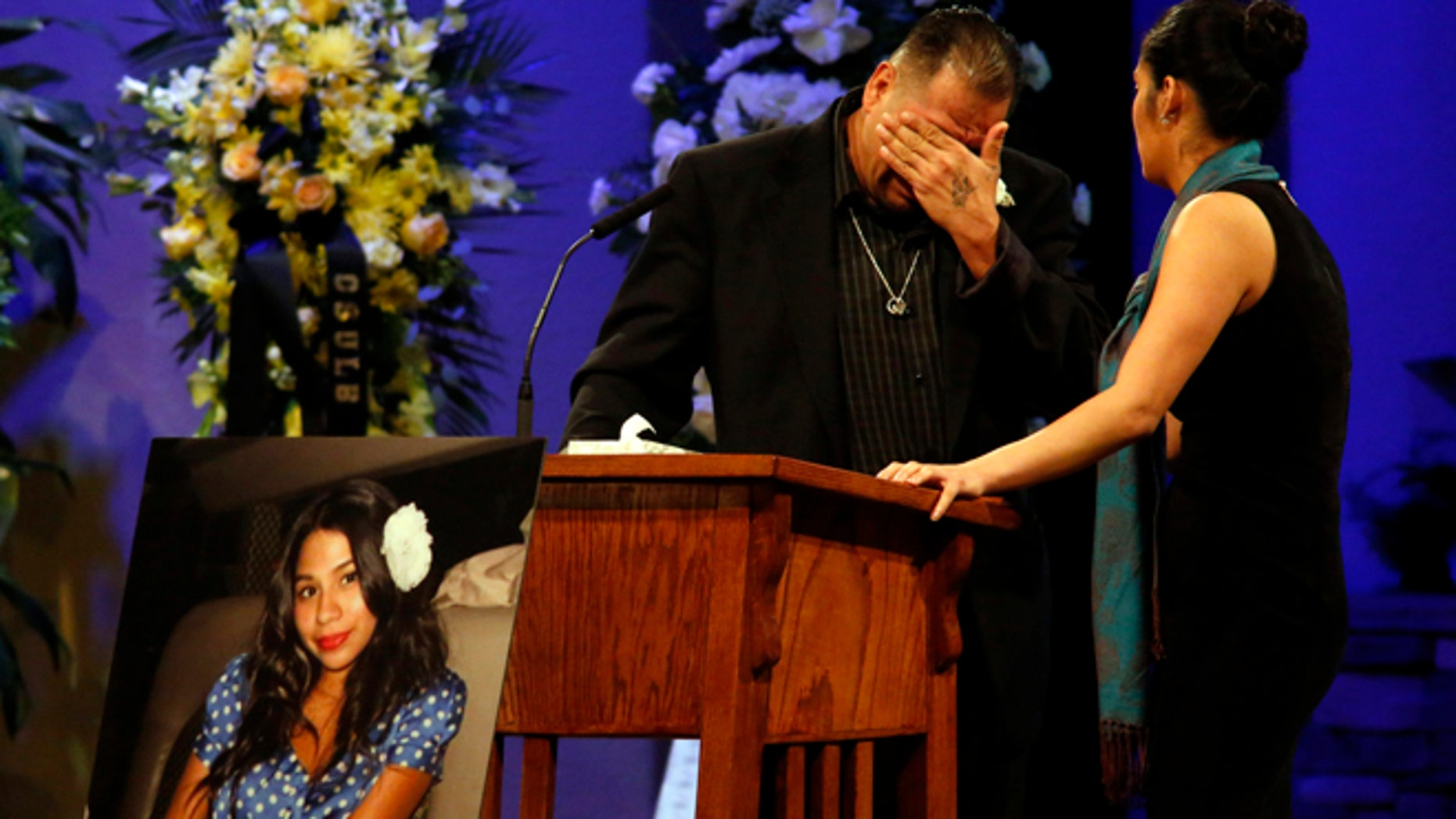 Reynaldo Gonzalez breaks down while remembering his daughter Nohemi Gonzalez, Paris attack victim, at her funeral at the Calvary Chapel in Downey, Calif., Friday, Dec. 4, 2015.  Gonzalez was the 23 year-old Cal State Long Beach student who was killed while dining with friends at a bistro in Paris last month.  (Genaro Molina/Los Angeles Times via AP, Pool)