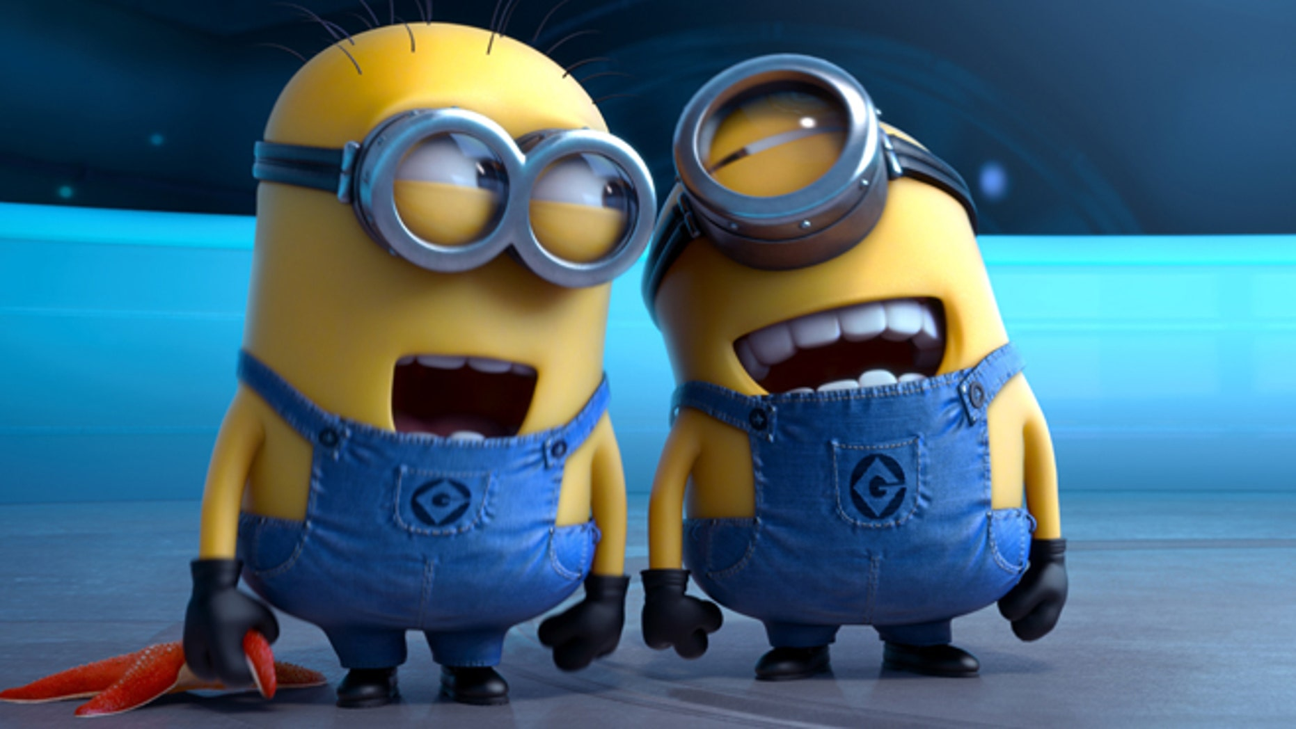 """FILE - This file photo provided by Universal Pictures shows the minion characters in the film """"Despicable Me 2.""""  Domestic box office numbers so far on this long Fourth of July holiday weekend are suggesting the the animated minions of family favorite, with a price tag one third of what The Lone Ranger cost to make, is outperforming the masked man by more than three to one. (AP Photo/Universal Pictures, File)"""