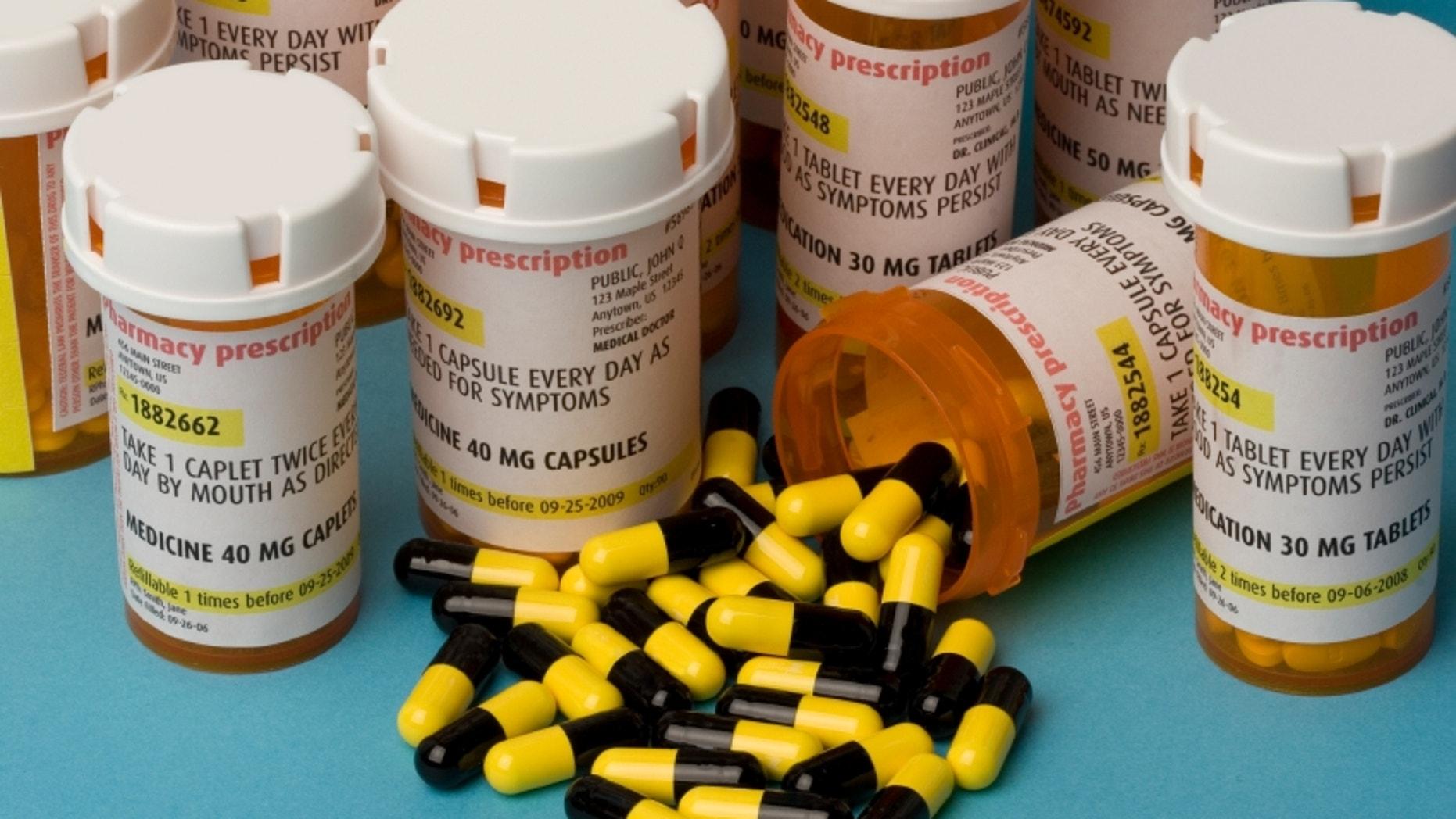 Bottles of prescription medication. Labels are fake, with false information.