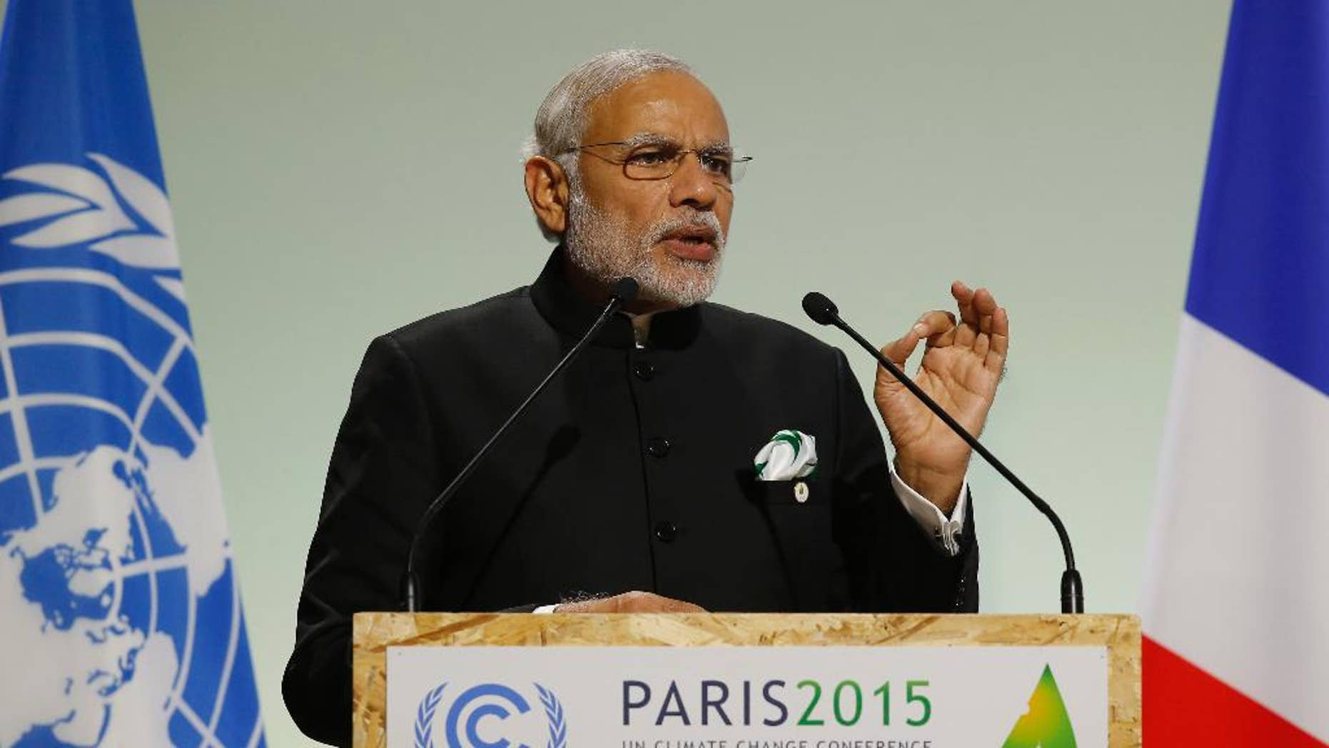 FILE- In this Nov. 30, 2015 file photo, India's Prime Minister Narendra Modi addresses world leaders at the COP21, United Nations Climate Change Conference, in Le Bourget, outside Paris. India's leader says his country will ratify the Paris Agreement on climate change early next month. Modi said Sunday that his government will ratify the agreement Oct. 2, coinciding with the birth anniversary of India's independence leader Mohandas Gandhi. (AP Photo/Michel Euler, File)