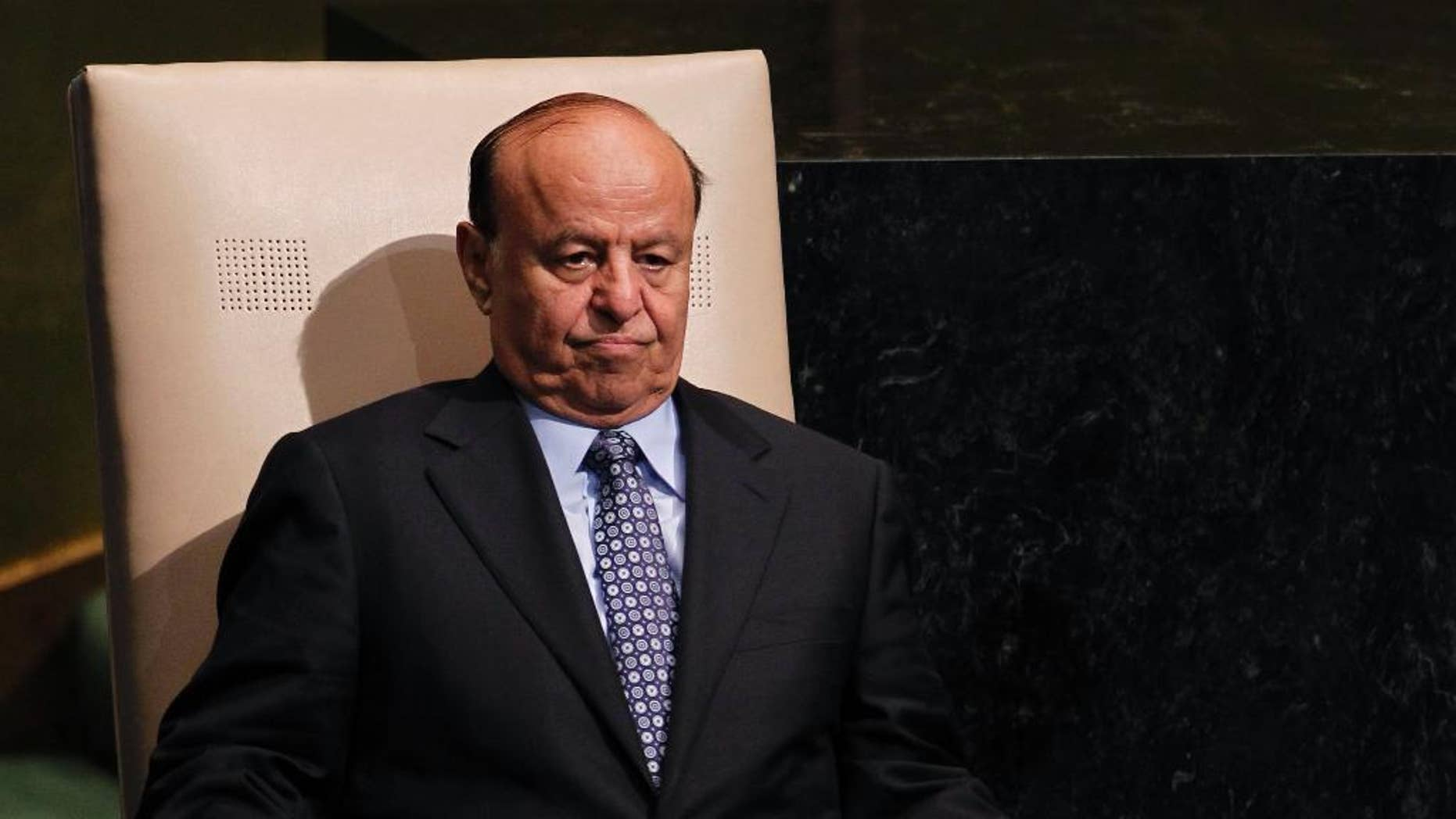 FILE - In this Wednesday, Sept. 26, 2012 file photo, Abed Rabbo Mansour Hadi, President of Yemen, sits after addressing the 67th session of the United Nations General Assembly at U.N. headquarters. Yemen's embattled president fled his palace in Aden for an undisclosed location Wednesday as Shiite rebels offered cash bounty for his capture and arrested his defense minister. Hadi left just hours after the rebels' own television station said they seized an air base where U.S. troops and Europeans advised the country in its fight against al-Qaida militants.  (AP Photo/Jason DeCrow, File)
