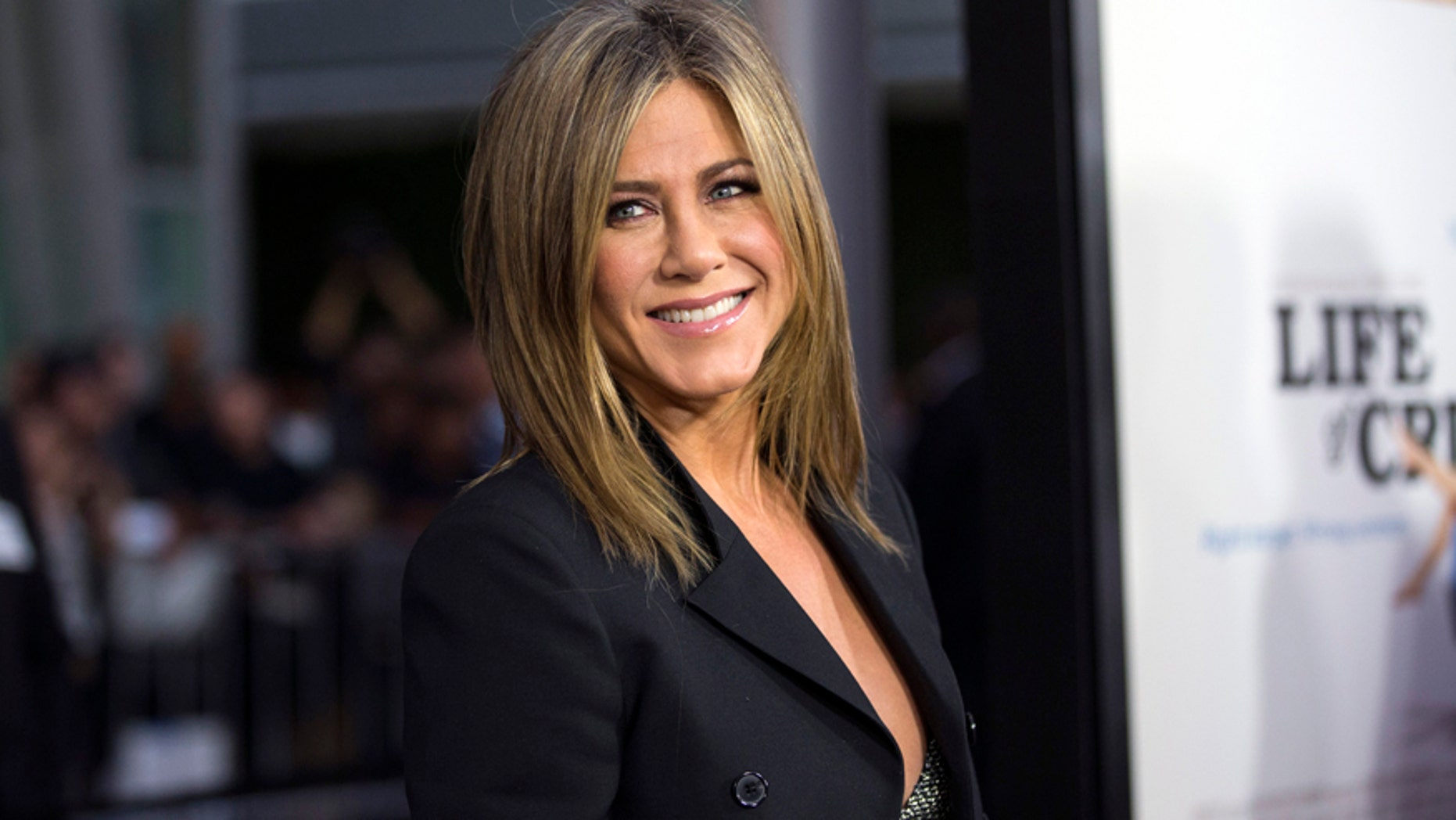 """Cast member Jennifer Aniston poses at the premiere of """"Life of Crime"""" in Los Angeles, California August 27, 2014."""