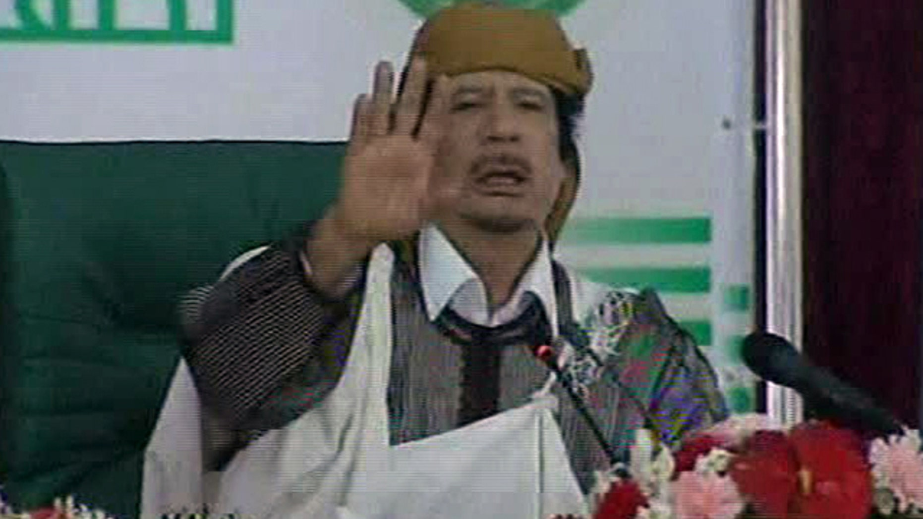 March 2: This video image taken from Libyan state television broadcast shows Libyan leader Muammar al-Qaddafi addressing supporters and journalists in Tripoli, Libya.