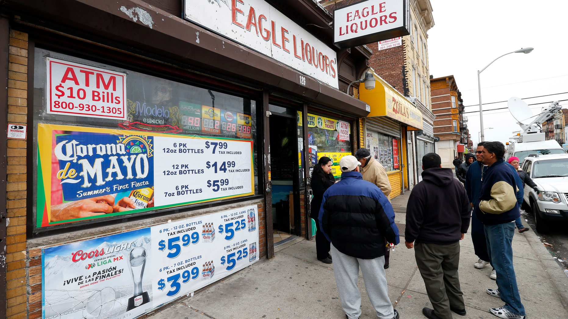 March 25, 2013: Crowds stand outside Eagles Liquors in Passaic, N.J. The store sold the winning $338 million Powerball ticket that was claimed by a New Jersey resident later identified as 44-year-old Pedro Quezada. (AP)