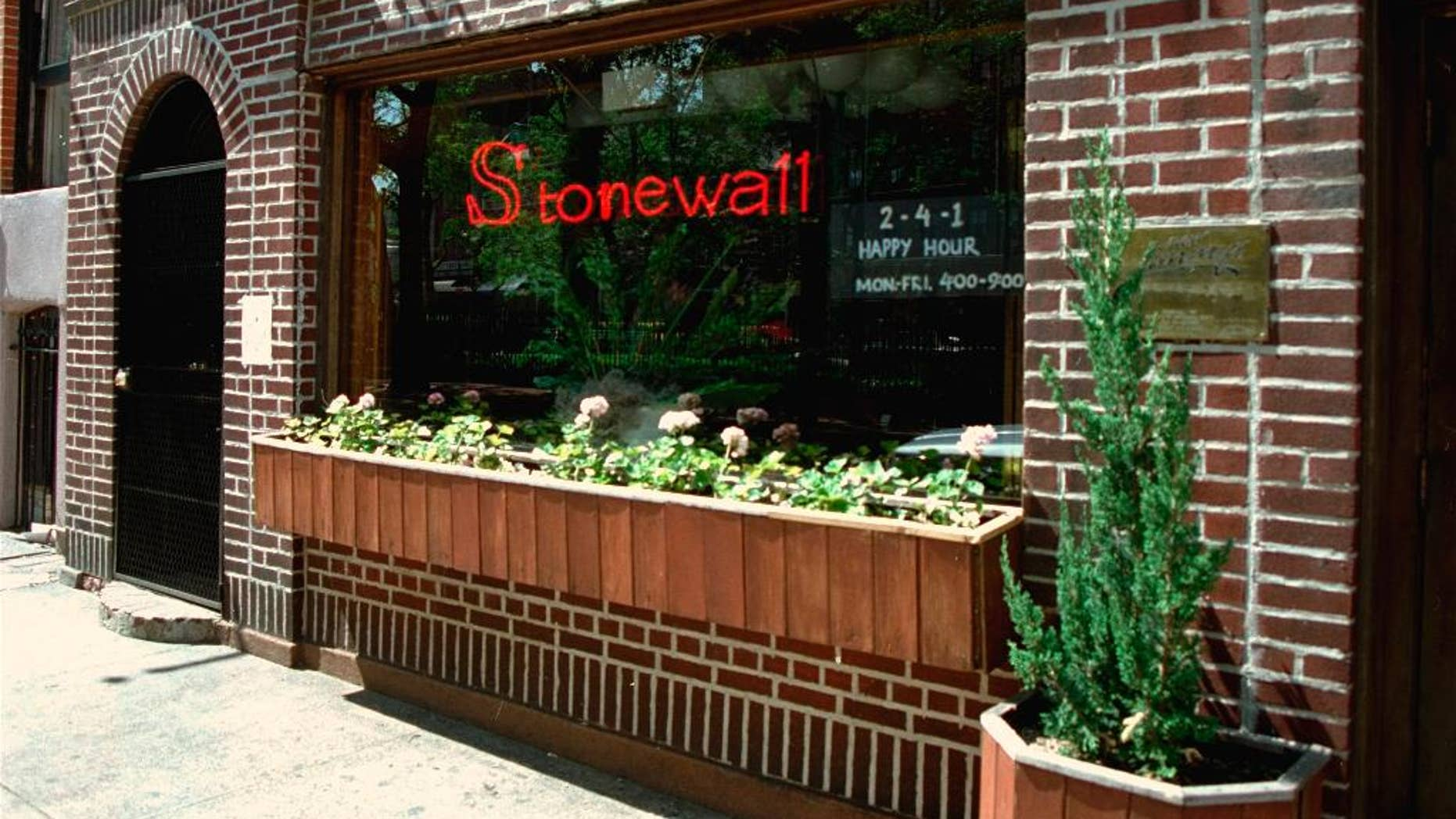 FILE - This May 1994 file photo shows an exterior view of the Stonewall Inn in the Greenwich Village section of New York, site of the 1969 riot that sparked the Gay Rights Movement. New York City police are searching for a man suspected of sexually assaulting a transgender woman in a bathroom at the historic Stonewall Inn bar. Police said Monday, March 28, 2016, the victim was in the unisex bathroom when the unknown man enters and apparently sexually assaults her.  (AP Photo/Kevin Larkin, File)