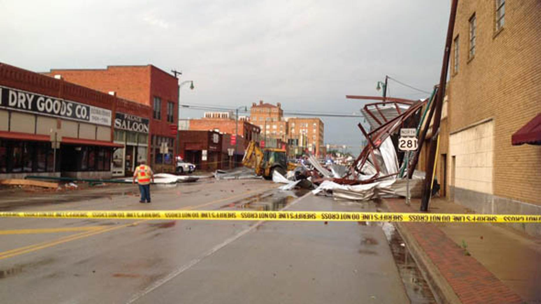 May 19, 2015: Emergency workers survey the damage after a tornado struck Mineral Falls, Texas. (Fox4News.com)