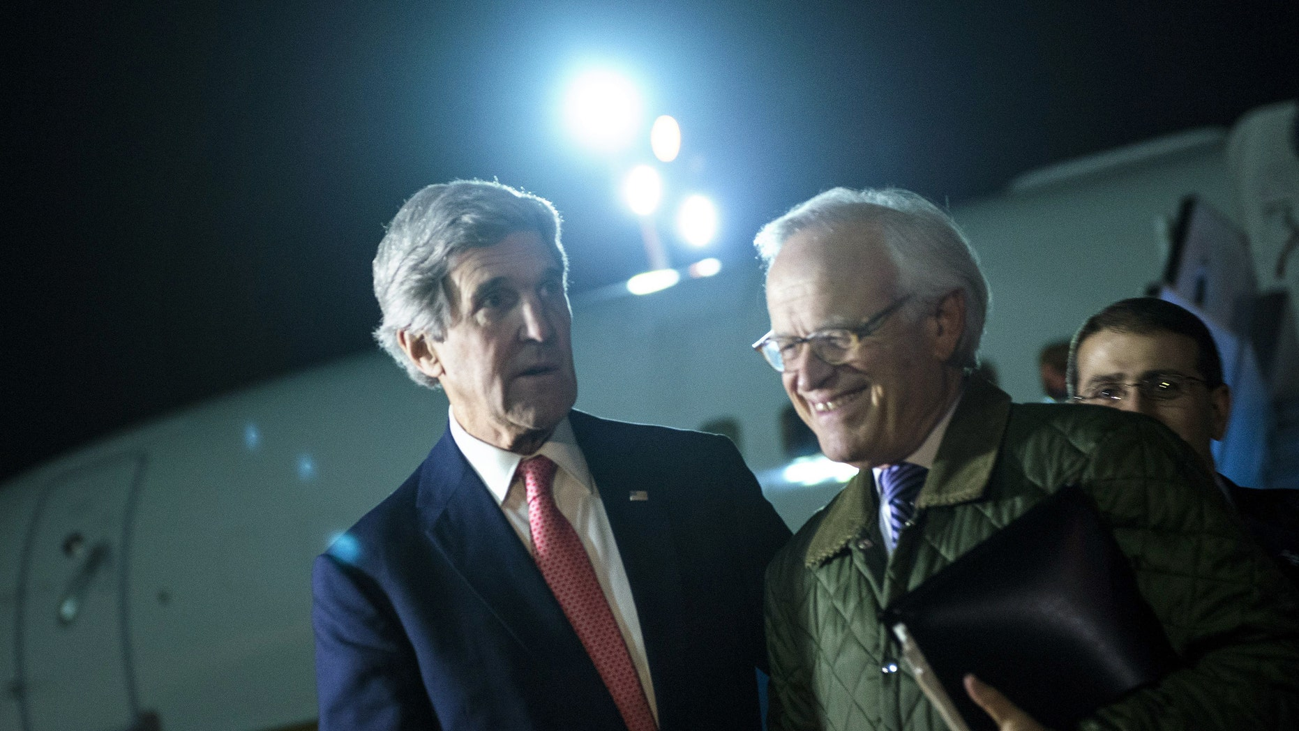 US Secretary of State John Kerry, left, walks with US Special Envoy for Israeli-Palestinian Negotiations Martin Indyk, right, while returning from a trip to Jordan and Saudi Arabia, at Ben Gurion International Airport, Tel Aviv Israel, on Sunday Jan. 5, 2014.  Kerry continues his regional peace-making efforts Sunday. (AP Photo / Brendan Smialowski, Pool)