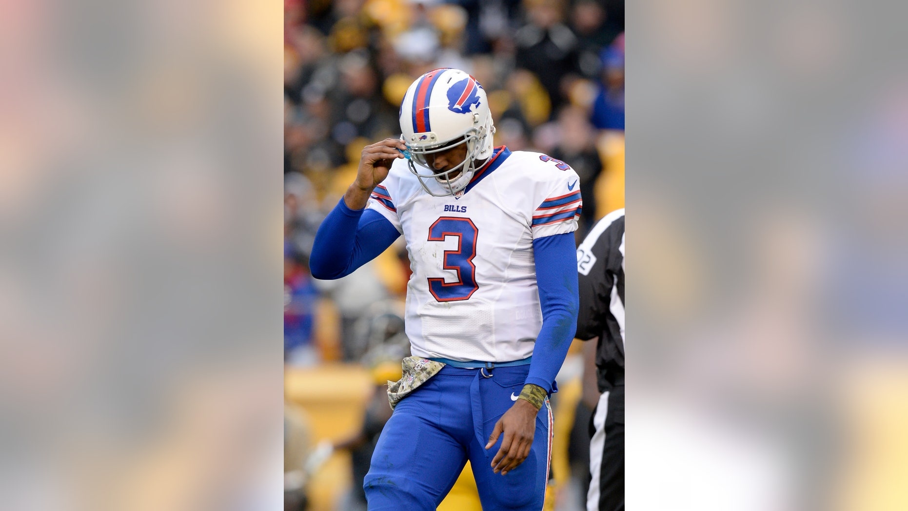 Buffalo Bills' EJ Manuel walks off the field after being tackled during the second half of an NFL football game against the Pittsburgh Steelers, Sunday, Nov. 10, 2013, in Pittsburgh. (AP Photo/Don Wright)