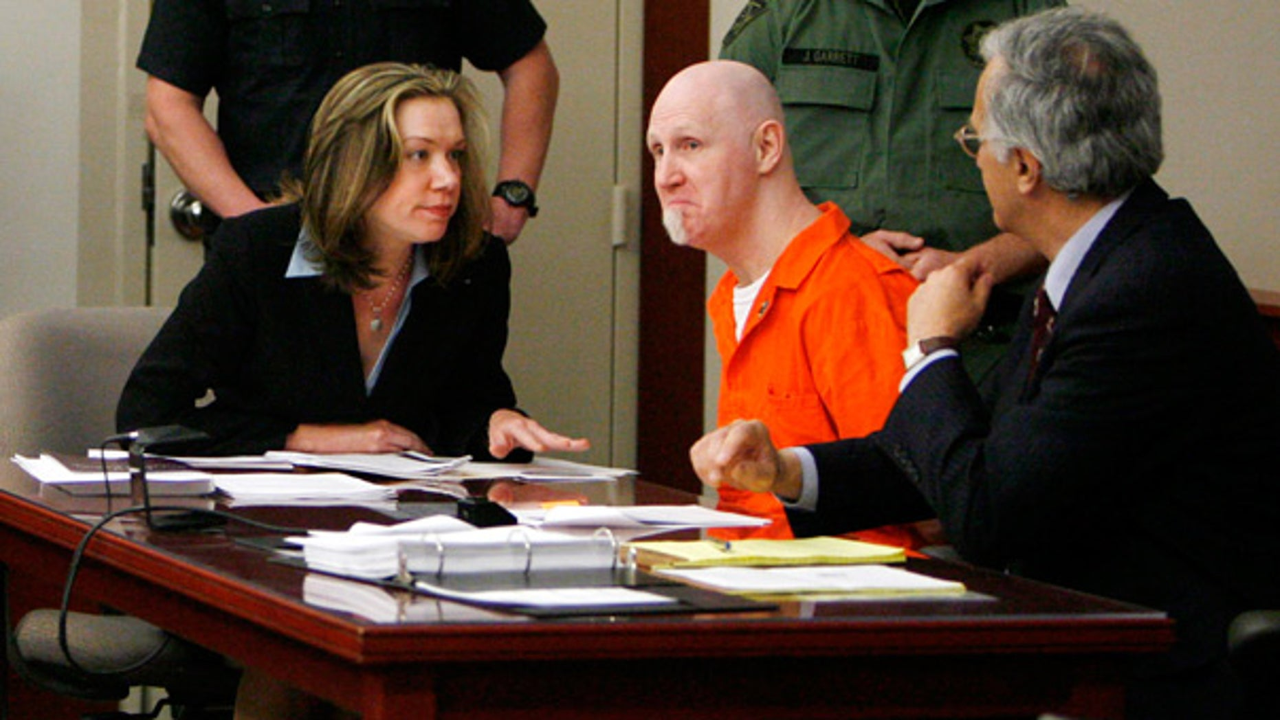 April 23: Convicted murderer Ronnie Gardner sits with his defense team at the Matheson Courthouse in Salt Lake City, Utah.
