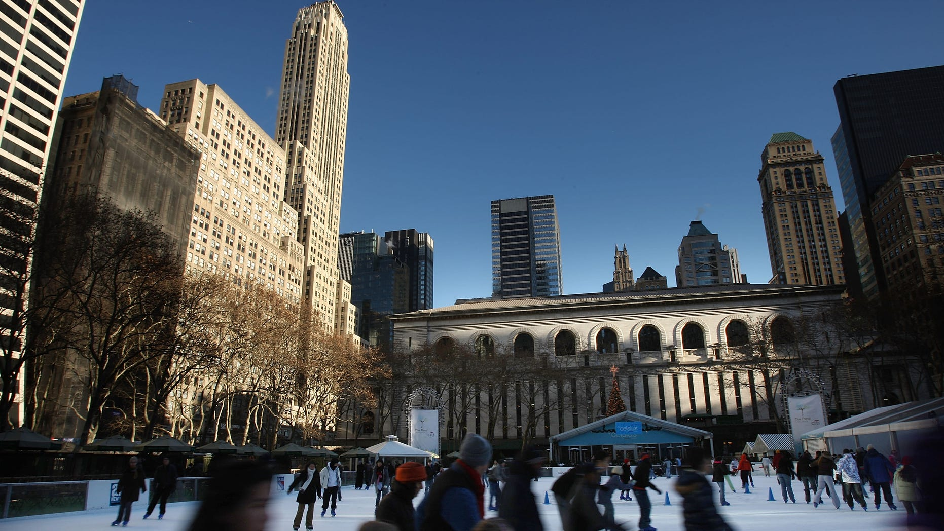 NEW YORK - JANUARY 03:  Ice skaters skate on the rink at Bryant Park January 3, 2008 in New York City. While much of the East Coast is experiencing freezing temperatures, significantly warmer weather is forecast for the weekend.  (Photo by Spencer Platt/Getty Images)