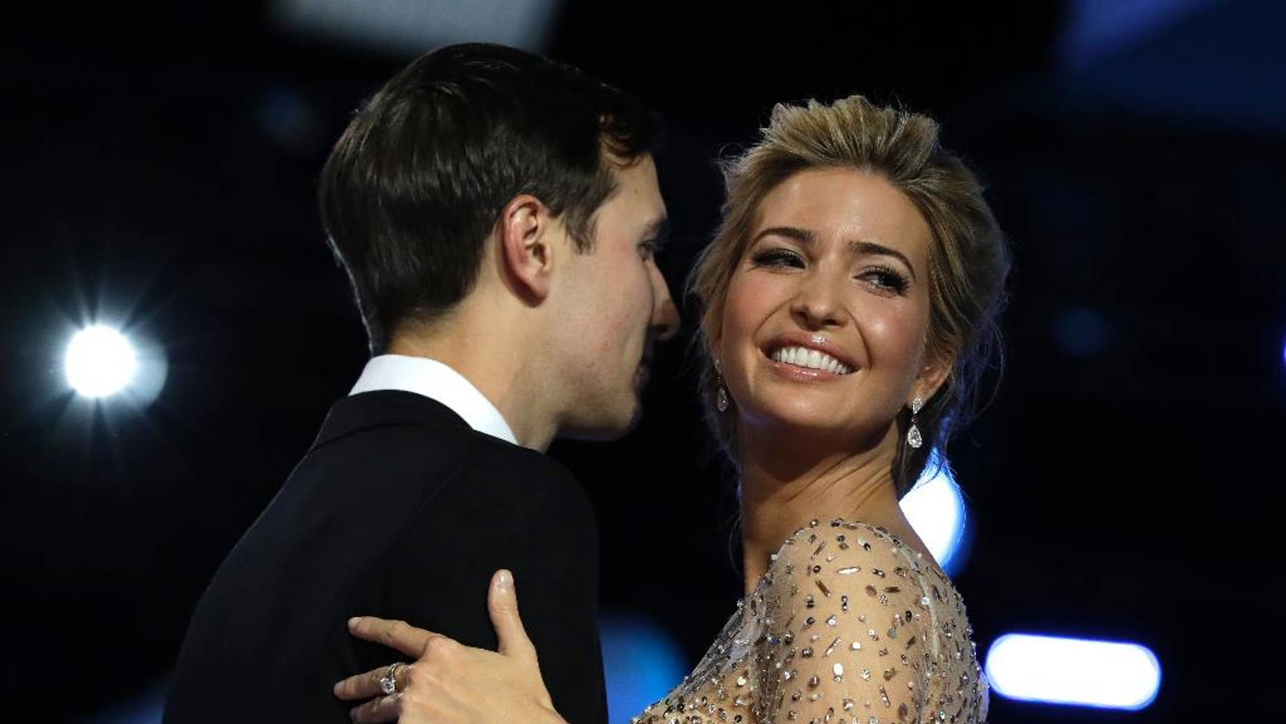FILE -- In this Friday, Jan. 20, 2017 file photo, Ivanka Trump and her husband Jared Kushner dance at the Freedom Ball, in Washington. Is Ivanka Trump really Jewish? Last year, Israel's religious authorities issued a ruling that raised doubts about her conversion to Judaism. But now that her father is president, they have changed their tune, raising eyebrows among advocates who have long pushed the country's rabbinical establishment to be more tolerant toward converts. (AP Photo/Evan Vucci, File)