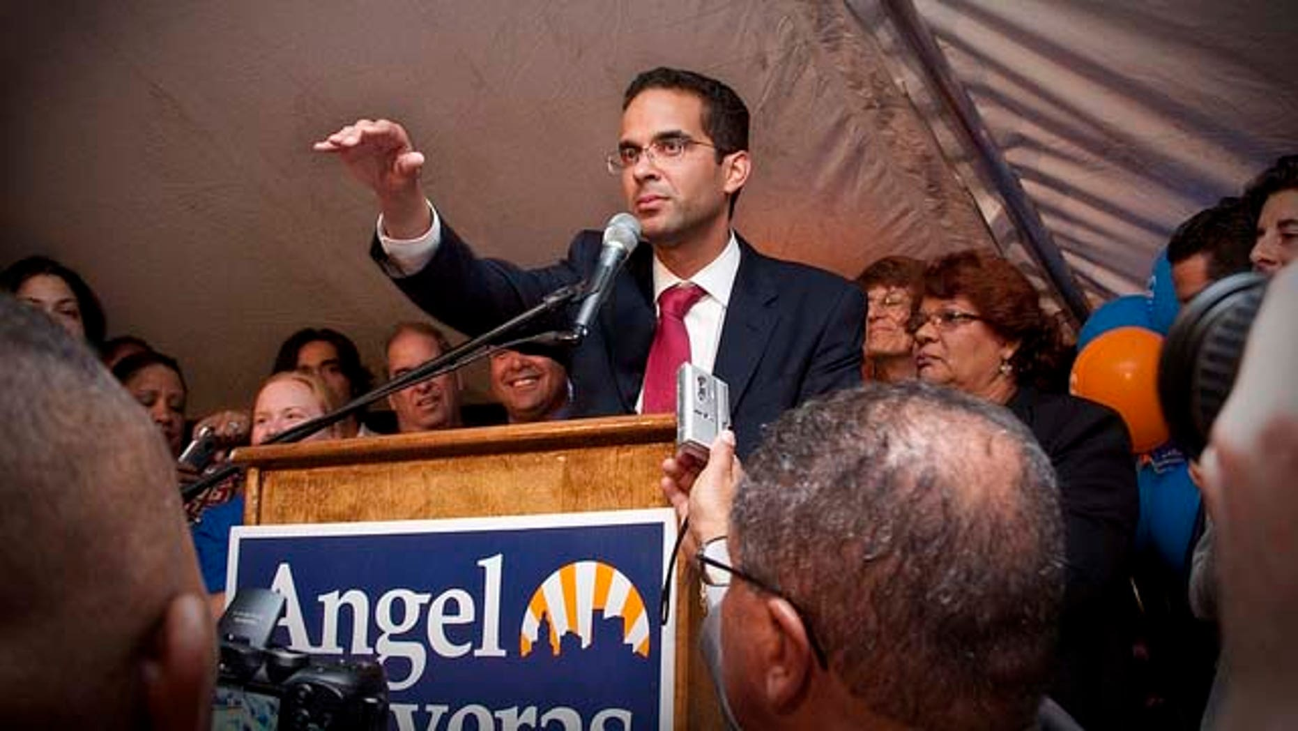 Angel Taveras is on the verge of becoming Providence's first Latino mayor. The son of immigrants has been viewed as a role model for younger Dominicans.