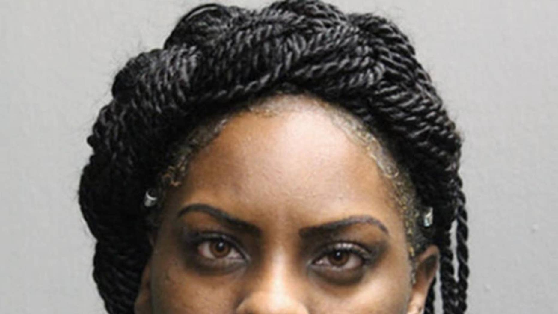 This booking photo provided by the Chicago Police Department shows Larrinita Starks, who has been charged with child endangerment after her 5-year-old daughter accidentally shot and wounded herself in the abdomen with a handgun that she found in her Stark's purse Tuesday night, Jan. 17, 2017. (Chicago Police department via AP)
