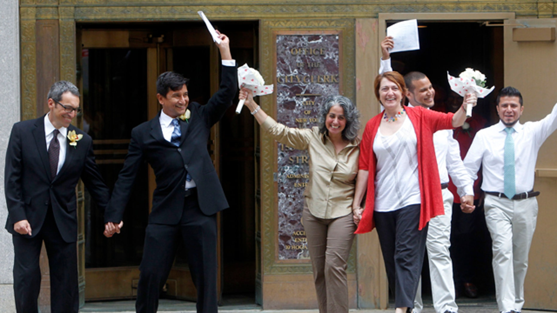 From left, couples Nevin Cohen and Daniel Hernandez, Carol Anastasio and Miriam Brown, all of New York, and Marcos Chaljub and Freddy Zambrano, of Astoria, in the Queens borough of New York, celebrate after getting married at the Manhattan City Clerk's office, Sunday, July 24, 2011 in New York. (AP Photo/Jason DeCrow)