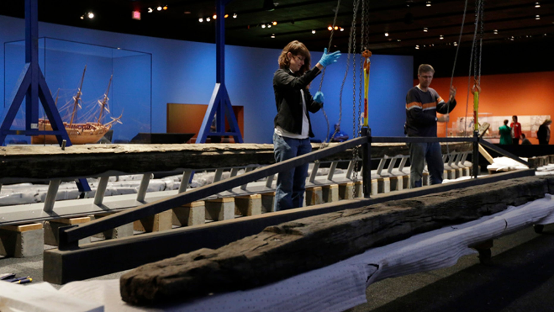 In this Oct. 22, 2014 photo work to reassemble the 54-foot oak French frigate La Belle begins at the Bullock Texas State History Museum in Austin, Texas.  Archaeologists are beginning to reassemble the remains of the ship recovered more than 300 years after the vessel was lost in a storm off the coast of Texas. (AP Photo/Eric Gay)