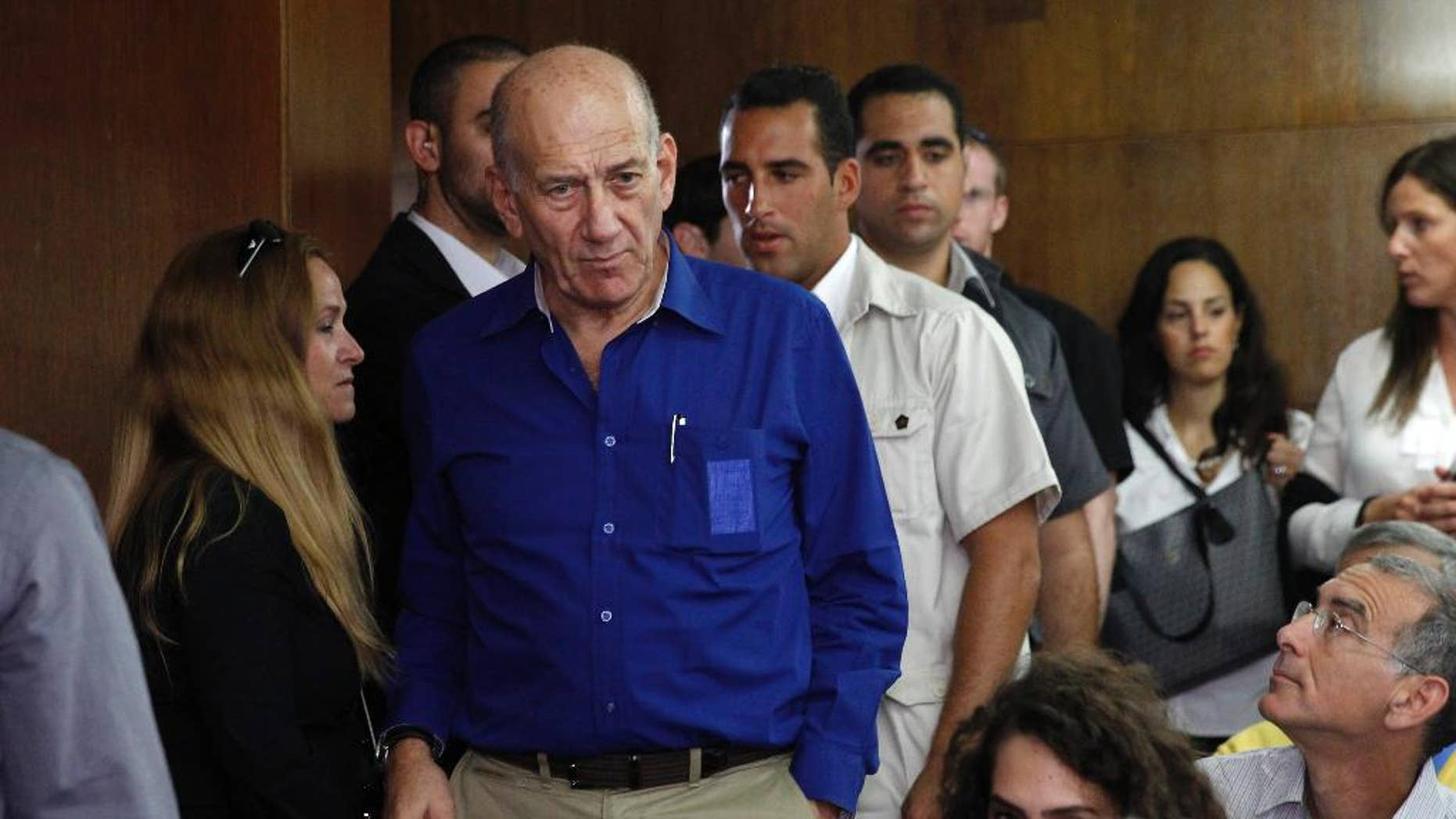 FILE - This May 13, 2014, file photo shows Israel's former Prime Minister Ehud Olmert at the Tel Aviv District Court in Israel.   Former Prime Minister Olmert was found guilty Monday, March 30, 2015, of fraud and breach of trust in a retrial on corruption charges, three years after being acquitted. (AP Photo/Finbarr O'Reilly, File)