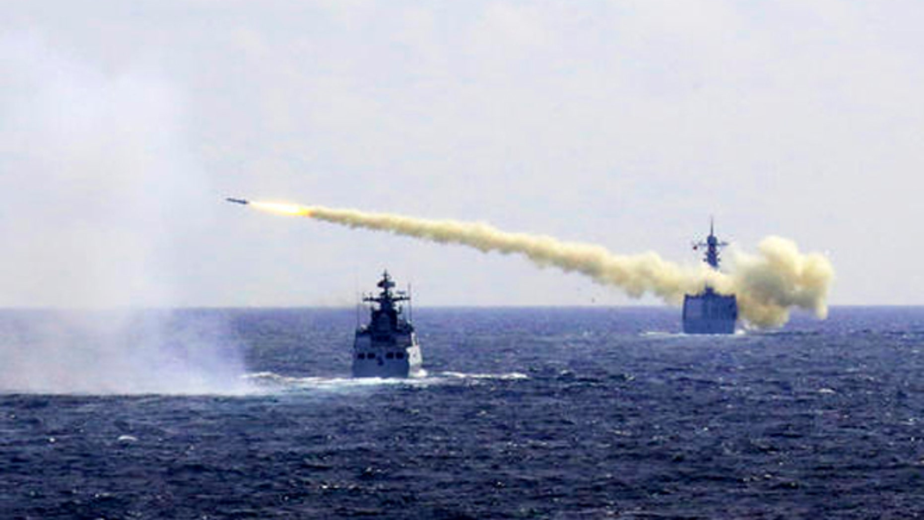 In this Monday, Aug. 1, 2016 photo released by Xinhua News Agency, a missile is launched from a navy ship during a live ammunition drill in the East China Sea. (Associated Press)