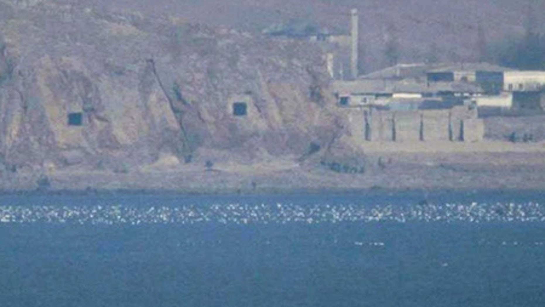FILE: Two caves with coastal artillery, left, are seen at the North Korean village of Haeju where North Korea's military units are stationed.