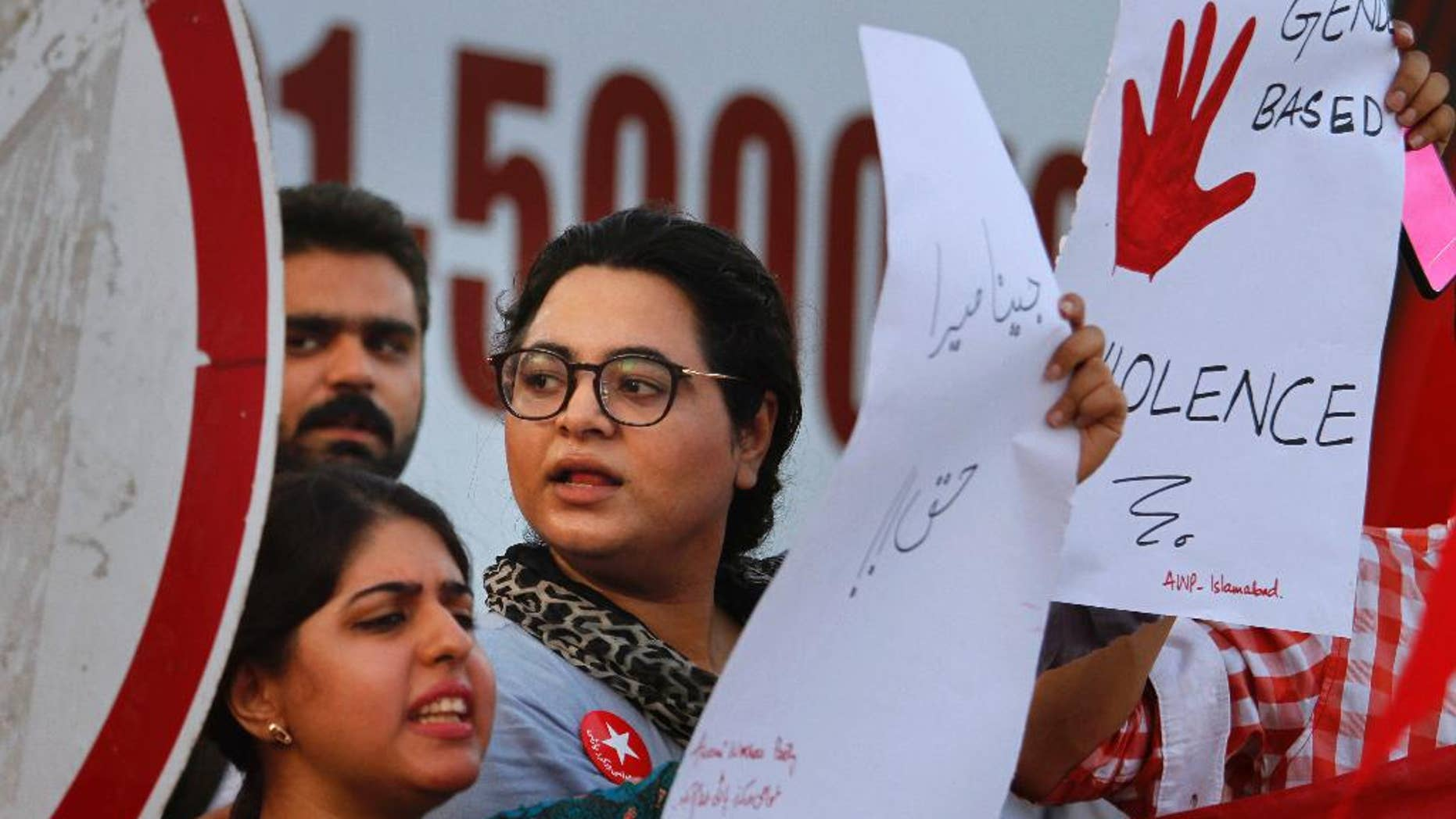 """FILE -- In this July 18, 2016 file photo, activists of the Awami Workers Party chants slogans during a demonstration to condemn the killing of model Qandeel Baloch and against """"honor killings,"""" in Islamabad, Pakistan. A Pakistani government-ordered police inquiry has recommended that the ex-husband and father of a British woman killed in Pakistan be tried on rape and murder charges. The report, shared exclusively with The Associated Press, describes the killing of Samia Shahid as """"premeditated, cold-blooded murder."""" It says that Shahid's father, Muhammad Shahid, stood guard while her ex-husband, Muhammad Shakeel, raped her. After that, they killed her together. (AP Photo/Anjum Naveed, File)"""