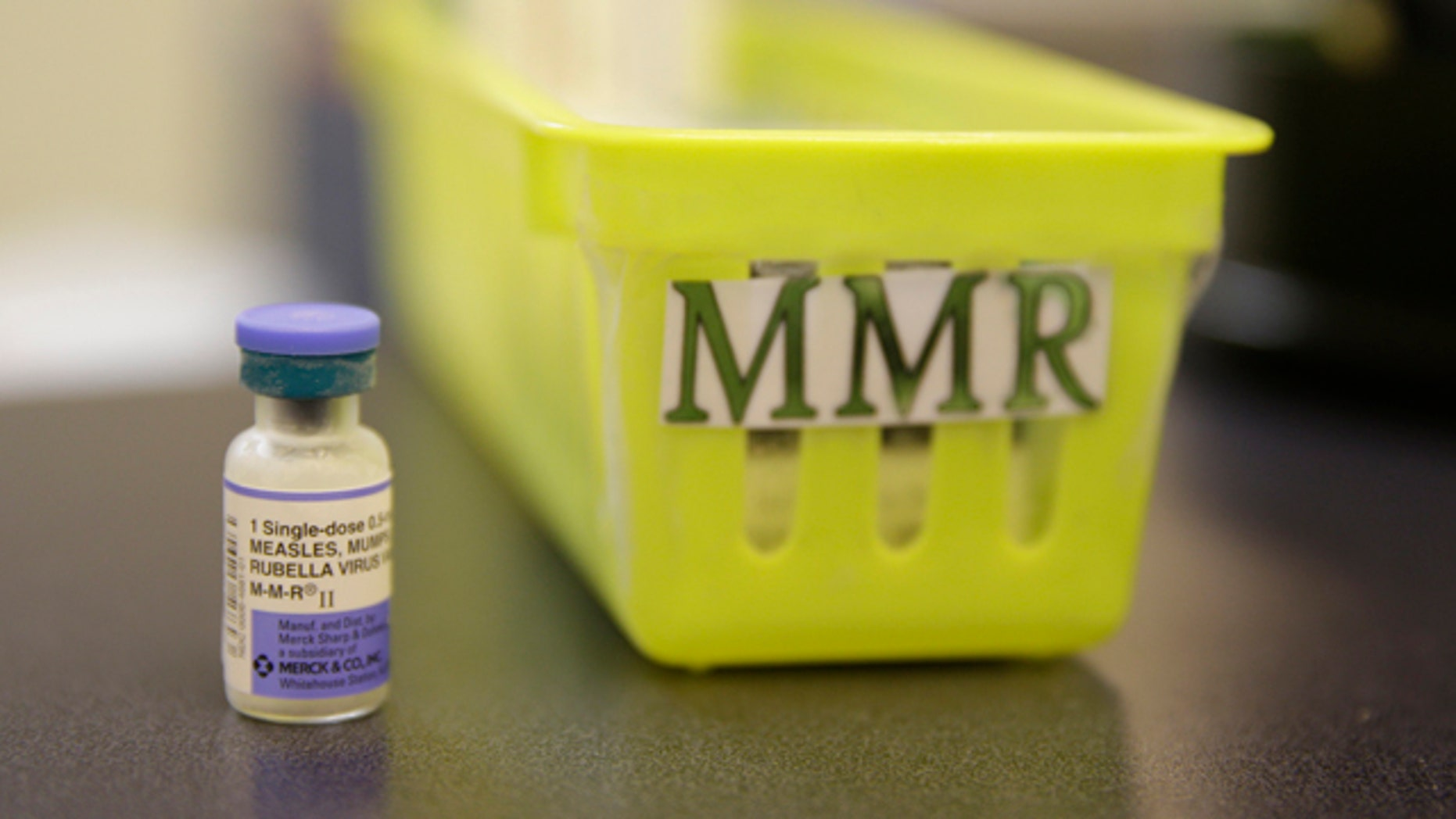 FILE- This Feb. 6, 2015, file photo shows a measles vaccine on a countertop at the Tamalpais Pediatrics clinic in Greenbrae, Calif. The Australian government has ramped up pressure on parents who oppose vaccination by threatening to withhold child care and other payments from families that fail to immunize their children. (AP Photo/Eric Risberg, File)