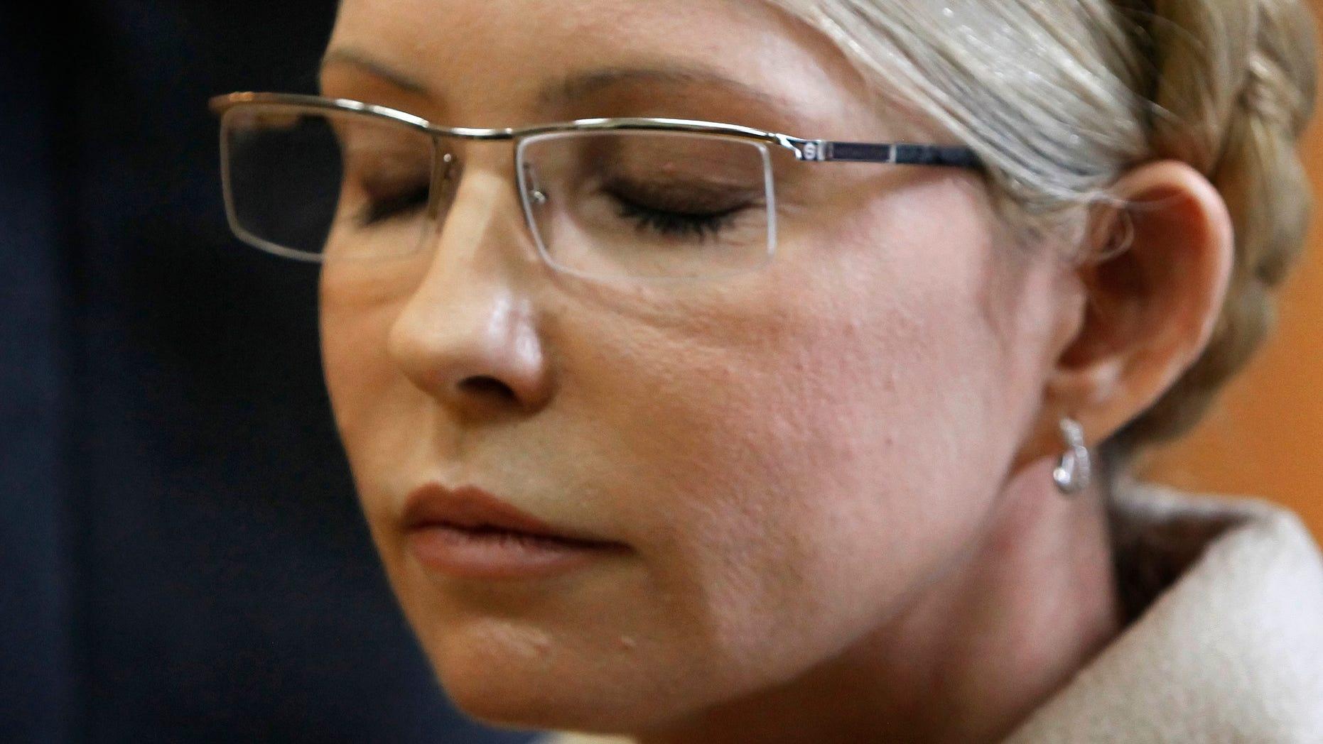 Former Ukrainian Prime Minister Yulia Tymoshenko reacts during her trial, at the Pecherskiy District Court in Kiev, Ukraine, Tuesday, Oct. 11, 2011.