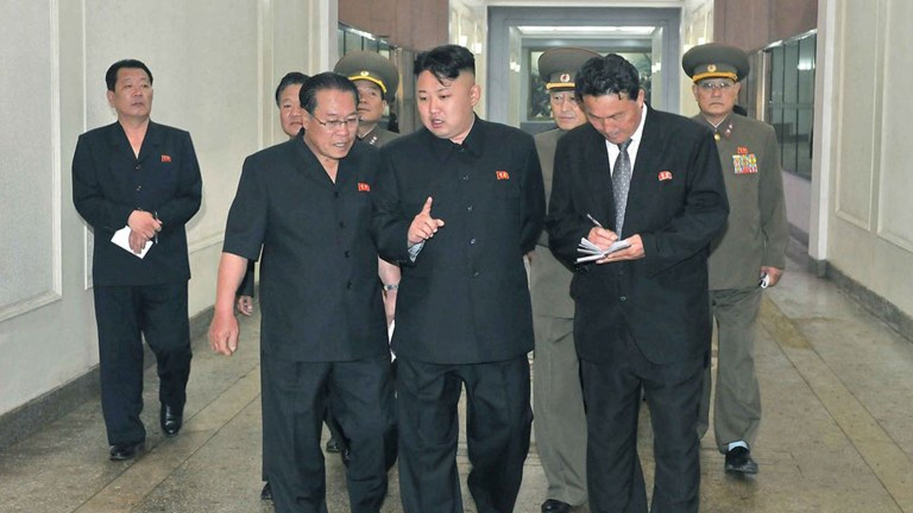 "This photo, released by North Korea's official Korean Central News Agency (KCNA) on June 18, 2013, shows N.Korean leader Kim Jong-Un (C) visiting a machine plant in North Phyongan Province. Kim reportedly gave copies of Adolf Hitler's ""Mein Kampf"" to his top officials, urging them to study it as a leadership skills manual."