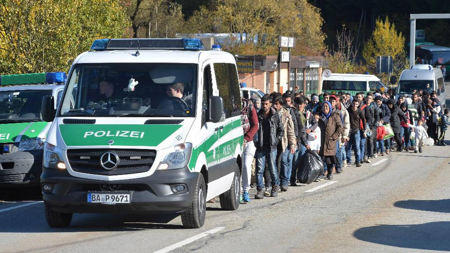 German federal police guide a group of migrants on their way.