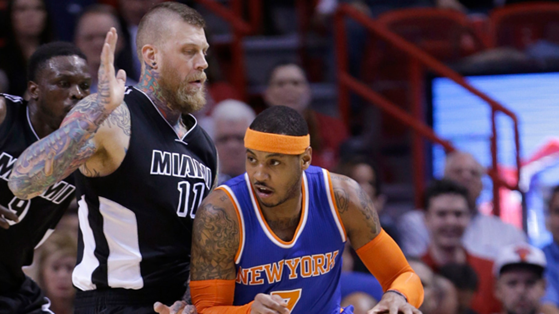 New York Knicks forward Carmelo Anthony (7) drives around Miami Heat forward Chris Andersen (11) during the first half of an NBA basketball game, Monday, Feb. 9, 2015, in Miami. (AP Photo/Wilfredo Lee),