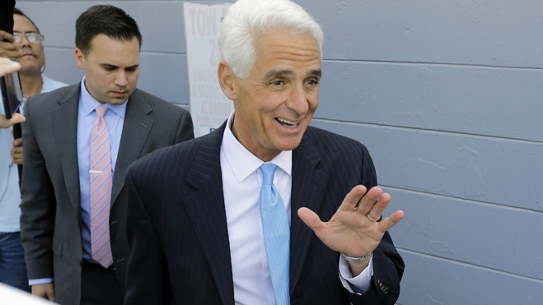 Florida Democratic gubernatorial candidate Charlie Crist  waves as he arrives to meet supporters at a phone bank during a campaign stop Tuesday, Nov. 4, 2014 in Tampa, Fla. Crist is running against Gov. Rick Scott. (AP Photo/Chris O'Meara)