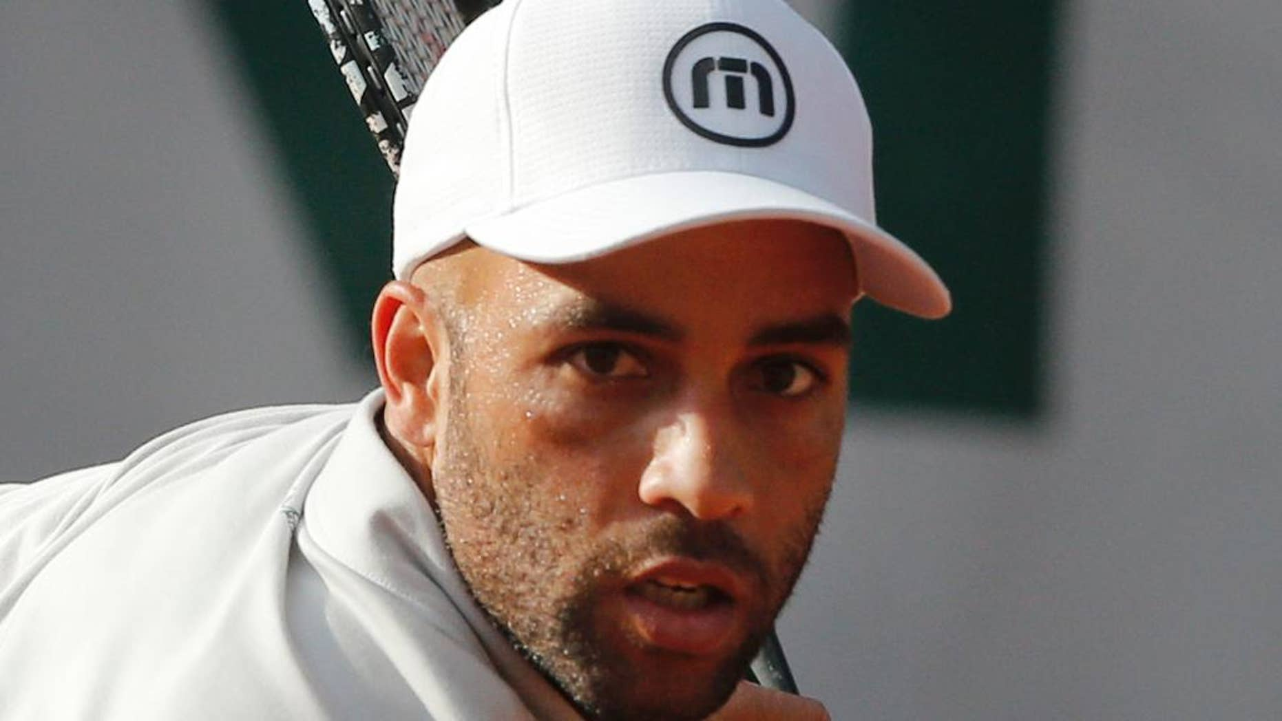 FILE - In this May 26, 2013, file photo, James Blake makes a return against Serbia's Viktor Troicki in their first round match of the French Open tennis tournament in Paris. New York City's police commissioner says he's been trying to apologize to former tennis professional James Blake, who was handcuffed by officers after a case of mistaken identity. Blake says he was standing outside a Manhattan hotel Wednesday, Sept. 9, 2015, waiting to head to the U.S. Open when an officer charging him. He says he was body-slammed and handcuffed. (AP Photo/Michel Spingler, File)