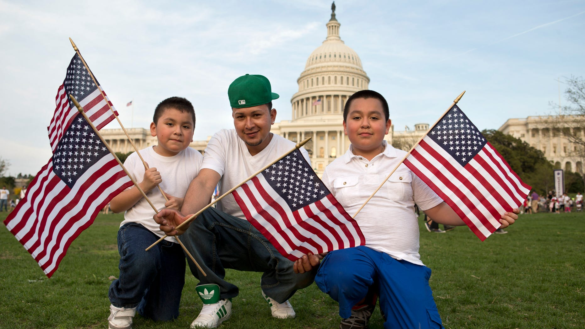 """Josue Benavides, 28, center, who is originally from El Salvador, poses for a portrait with his cousins Jonathan, 7, left, and Christopher Benavides, 11, of Alexandria, Va., after attending the """"Rally for Citizenship,"""" a rally in support of immigration reform, on Capitol Hill in Washington, on Wednesday, April 10, 2013. Bipartisan groups in the House and Senate are said to be completing immigration bills that include a pathway to citizenship for the nation's 11 million immigrants with illegal status. """"We need reform,"""" says Josue Benavides, """"so that the families can have a better life and avoid separations."""" (AP Photo/Jacquelyn Martin)"""