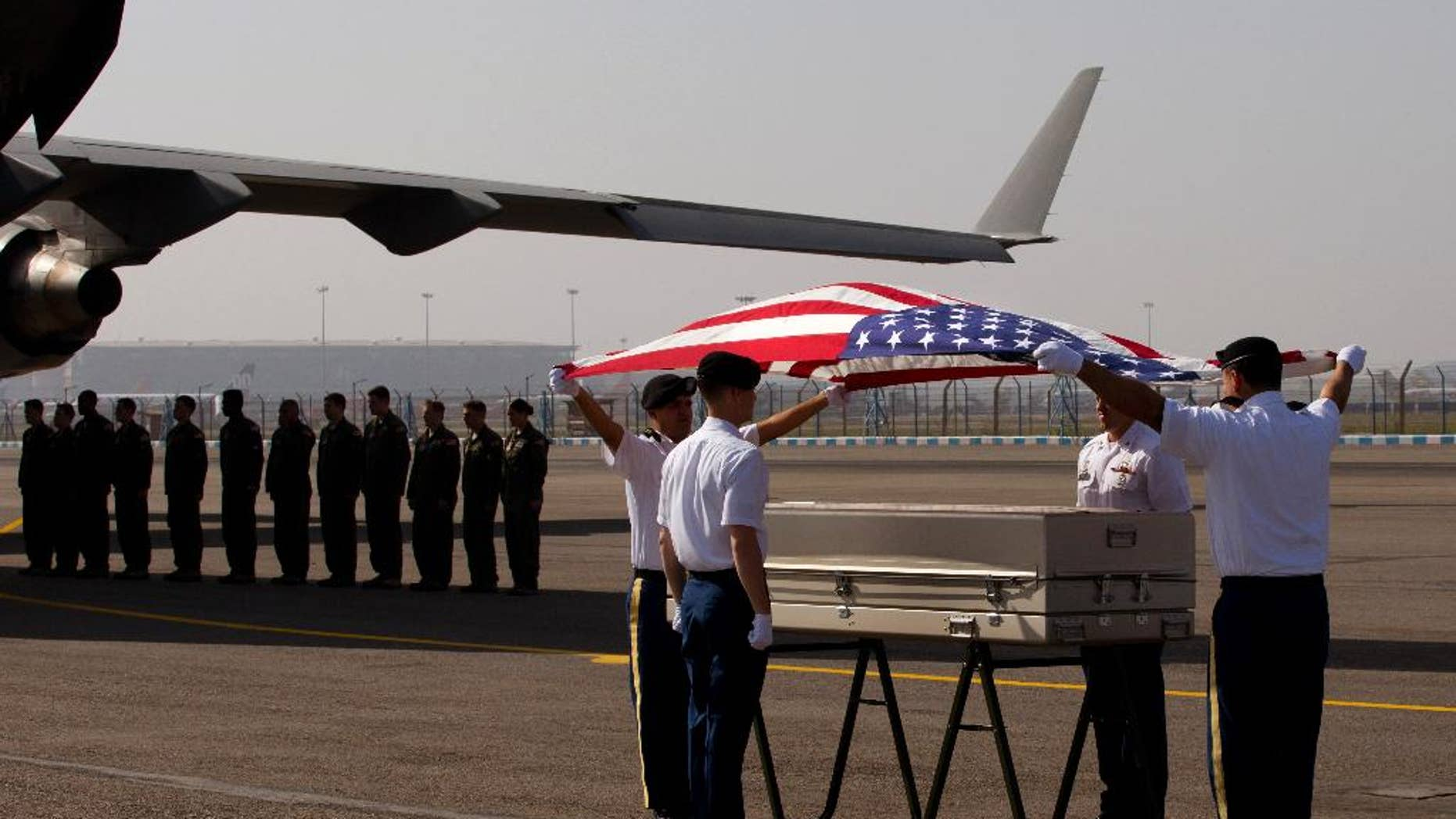APRIL 13: U.S. military members pay final respects to what they believe may be the remains of one to two crew members from a B-24 bomber that crashed during World War II at a ceremony at the Palam airport.
